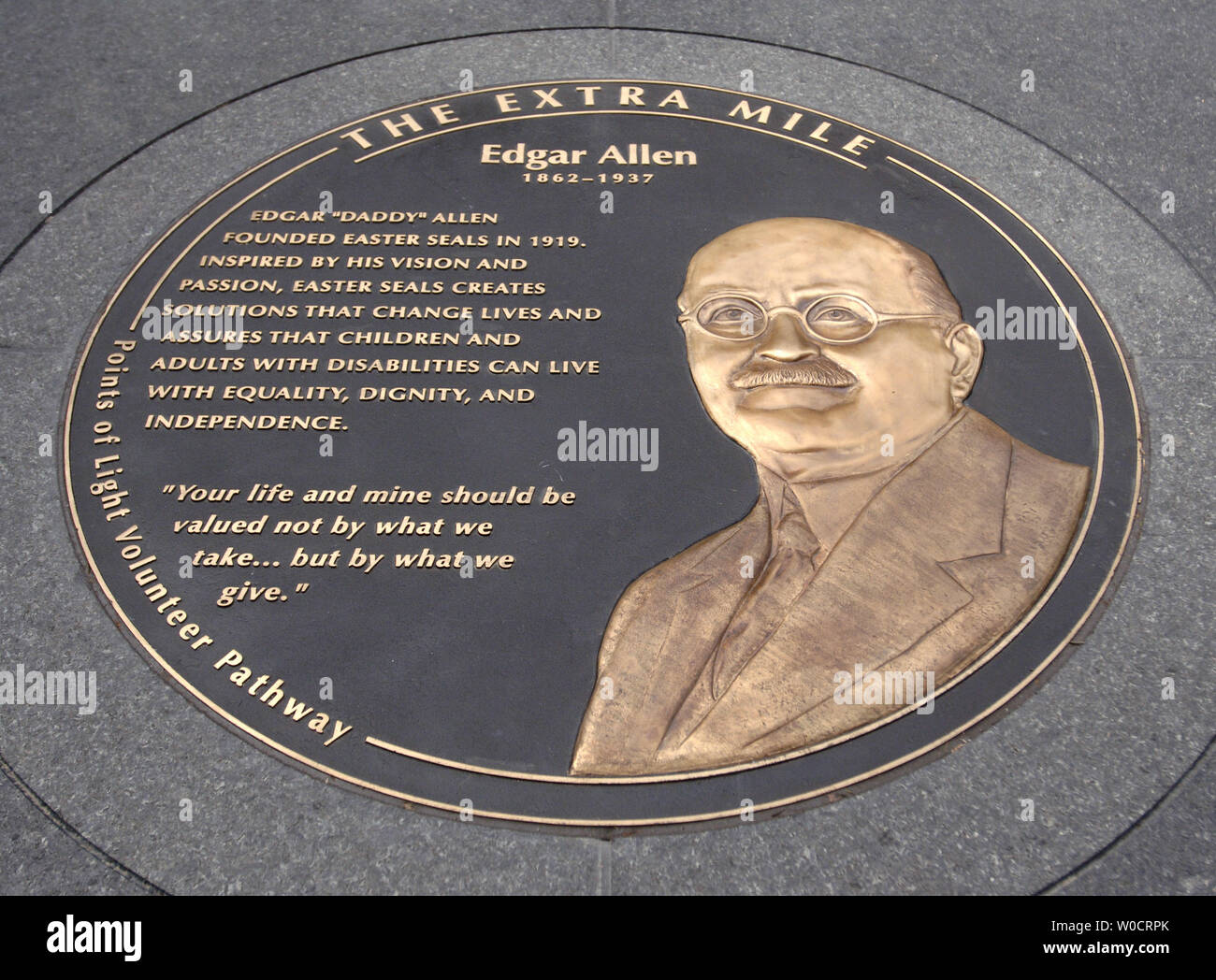A medallion honoring the lifetime service of Edgar Allen at the Extra Mile monument unveiling, in Washington on Oct. 14, 2005. The Extra Mile is a one mile long walk throughout downtown Northwest studded with bronze medallions honoring 70 Americans who gave their life to serving others (UPI Photo/Kevin Dietsch) Stock Photo