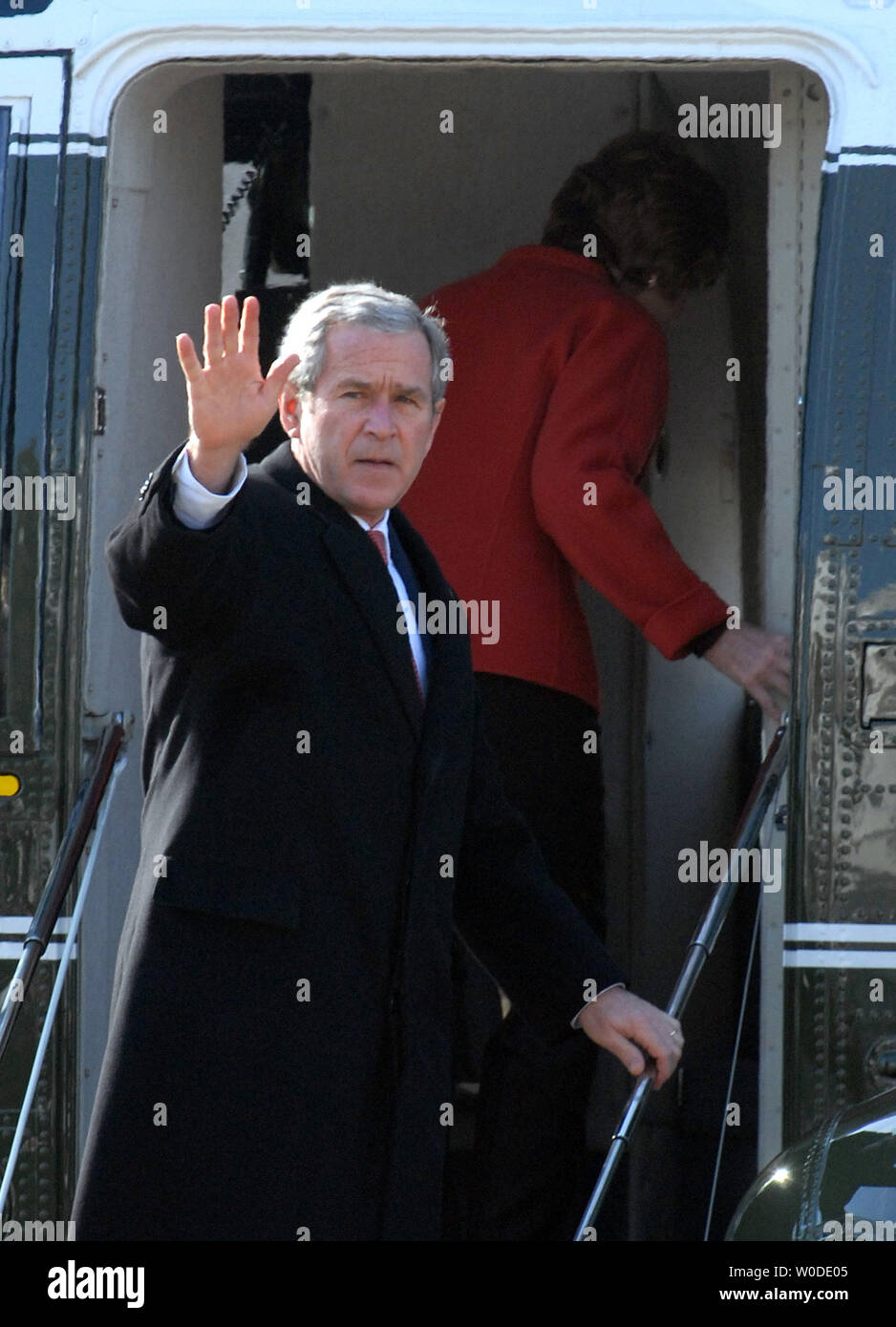 U.S. President George W. Bush waves as he and First Lady Laura Bush embark on Marine One en route to Latin America from the South Lawn of the White House in Washington on March 8, 2007.     (UPI Photo/Roger L. Wollenberg) - Stock Image