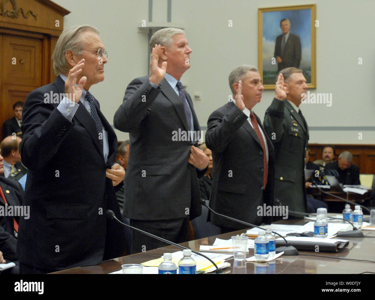 Former Defense Secretary Donald Rumsfeld, former Chairman of the Joint Chiefs of Staff retired Gen. Richard Myers, former commander of the U.S. Central Command retired Gen. John Abizaid and past commander of the U.S. Special Operations Command retired Gen. Bryan Brown (L to R) are sworn in prior to a House Oversight and Government Reform Committee hearing on 'The Tillman Fratricide: What the Leadership of the Defense Department Knew,' on Capitol Hill in Washington on August 1, 2007. Pat Tillman, a former NFL football player, was killed on April 22, 2004 in a 'friendly fire' incident while serv - Stock Image