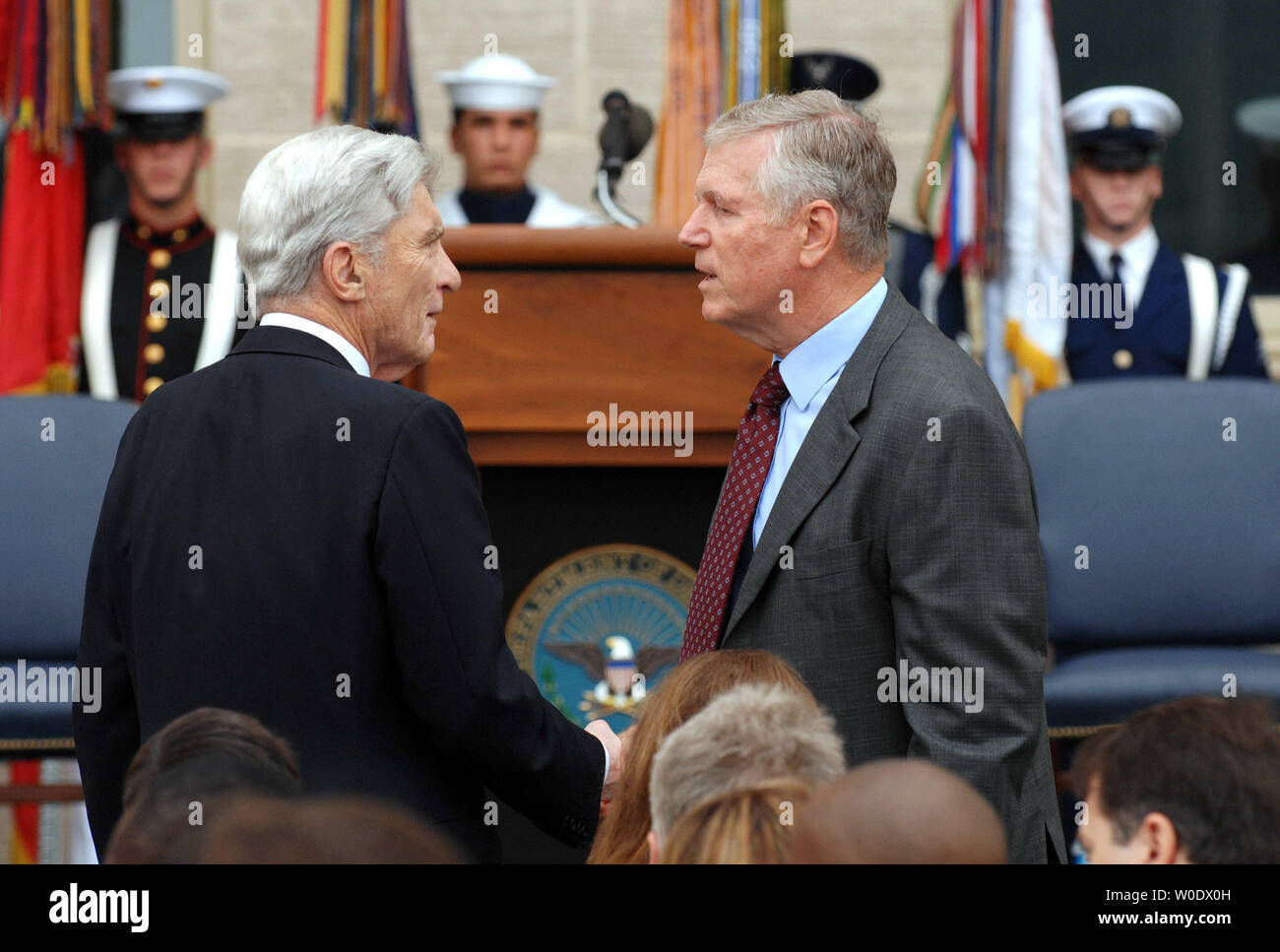 Sen. John Warner, R-VA, shakes hands with former Chairman of the Joint Chiefs of Staff Gen. Richard Meyers at the Pentagon's September 11th Wreath Laying Observance in Arlington, Virginia, on September 11, 2007.  (UPI Photo/Roger L. Wollenberg) - Stock Image