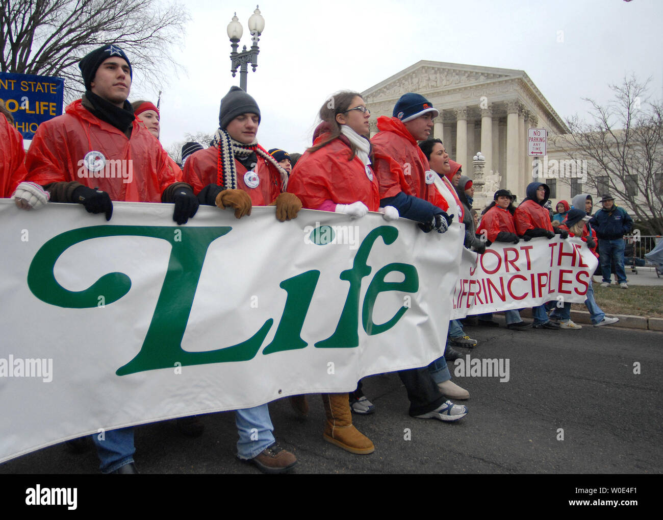 "Pro-life activists walk past the United States Supreme Court as they take part in the ""March for Life"" anti-abortion rally in Washington on January 22, 2008. The demonstration marked the 35th anniversary of the Supreme Court's 1973 decision in Roe vs Wade making abortions legal. (UPI Photo/Kevin Dietsch) Stock Photo"