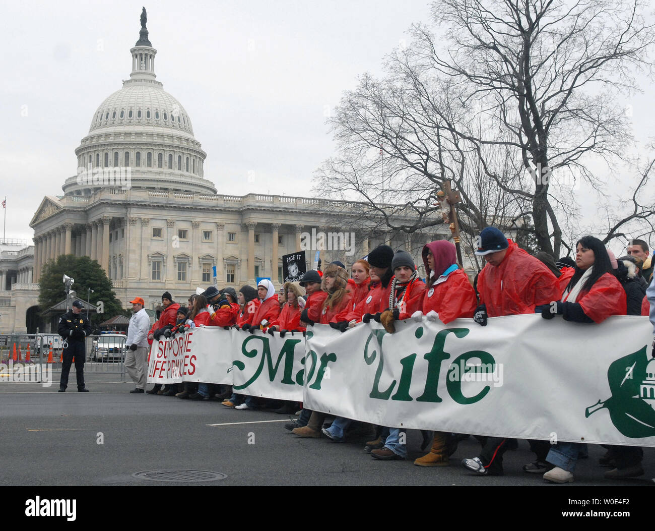 "Pro-life activists walk past the United States Capitol Building as they take part in the ""March for Life"" anti-abortion rally in Washington on January 22, 2008. The demonstration marked the 35th anniversary of the Supreme Court's 1973 decision in Roe vs Wade making abortions legal. (UPI Photo/Kevin Dietsch) Stock Photo"