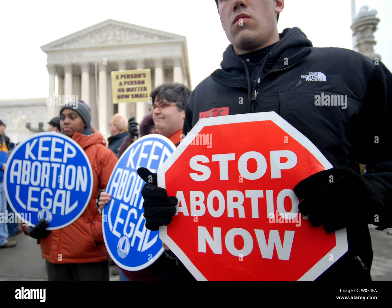 "Both Pro-life and Pro-Choice activists rally in front of the United States States Supreme Court during the ""March for Life"" anti-abortion demonstration in Washington on January 22, 2008. The demonstration marked the 35th anniversary of the Supreme Court's 1973 decision in Roe vs Wade making abortions legal. (UPI Photo/Kevin Dietsch) Stock Photo"