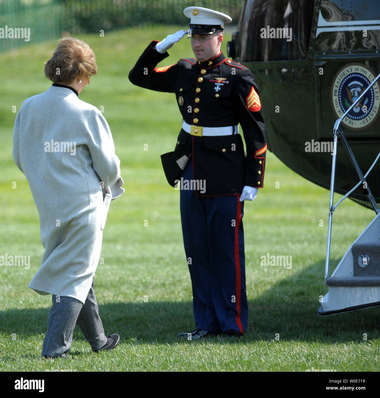 A Marine salutes as First Lady Laura Bush prepares to embark on Marine One as she and U.S. President George W. Bush depart the White House en route to Camp David for the weekend in Washington on March 20, 2008.   (UPI Photo/Roger L. Wollenberg) - Stock Image