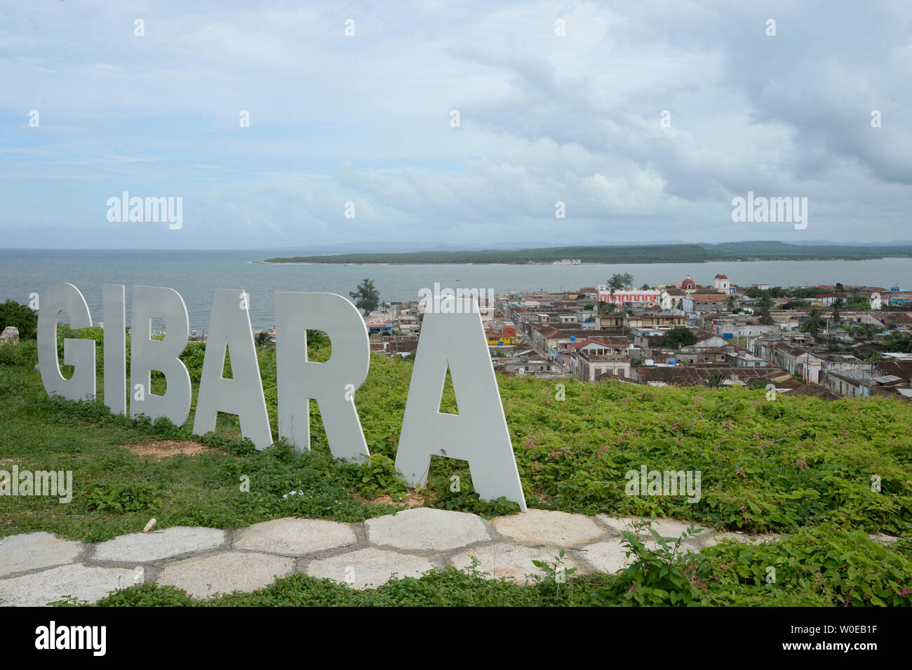 Cuba, Holguin area, GIBARA, a giant sign bearing the name of the city GIBARA is standing over the small town on a hill Stock Photo