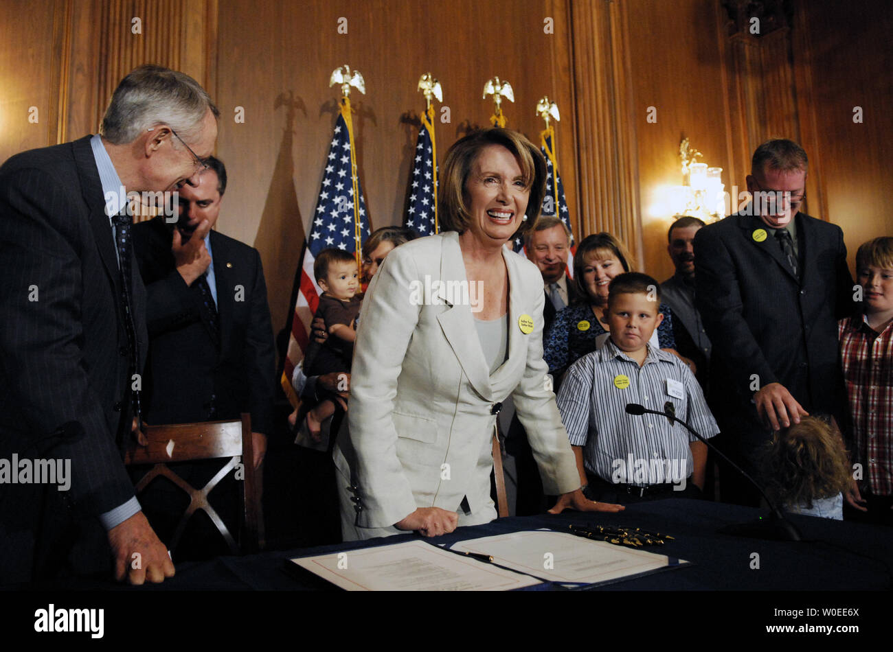 Speaker of the House Nancy Pelosi (D-CA) (C) and Senate Majority Leader Harry Reid (D-NV) (L) stand after signing a bill to reform the Consumer Product Safety Commission on Capitol Hill in Washington on August 1, 2008.  (UPI Photo/Alexis C. Glenn) Stock Photo