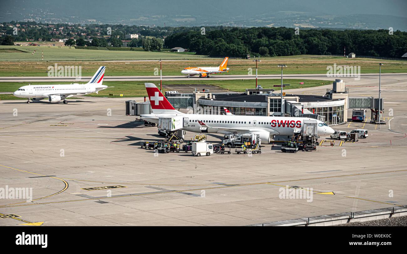 Geneva, Switzerland - 06/27/2019 : Planes and traffic on the Tarmac at an international Airport. Stock Photo