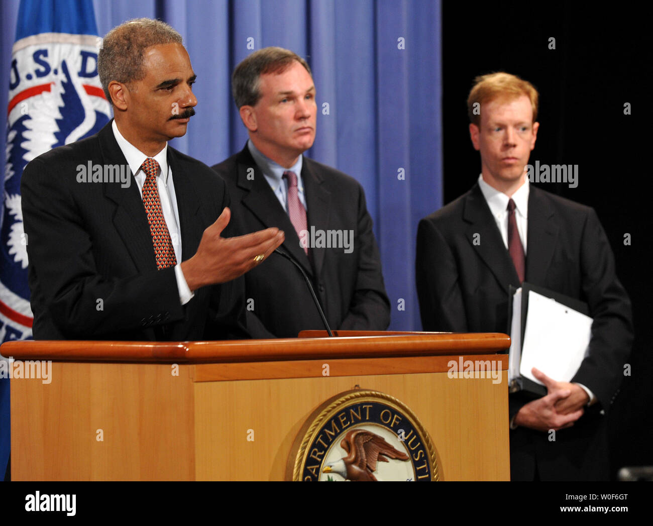 U S  Attorney General Eric Holder (L), joined by Patrick J