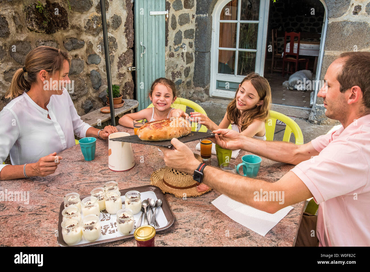 Auvergne - Rhone-Alpes - Haute-Loire - Family trip to the farm. Family tasting the good products of the farm. Stock Photo