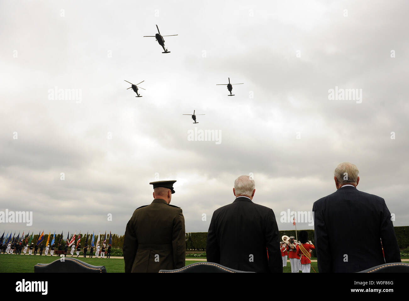 Secretary of Defense Robert M. Gates (C), Vice Chairman of the Joint Chiefs of Staff Marine Corps Gen. James E. Cartwright (L) and Retired Navy Adm. Jeremiah Denton, a former POW and senator, watch helicopters fly in formation over the Pentagon ceremony for National POW/MIA Recognition Day at the River Entrance Parade Field on September 18, 2009.     UPI/Roger L. Wollenberg - Stock Image