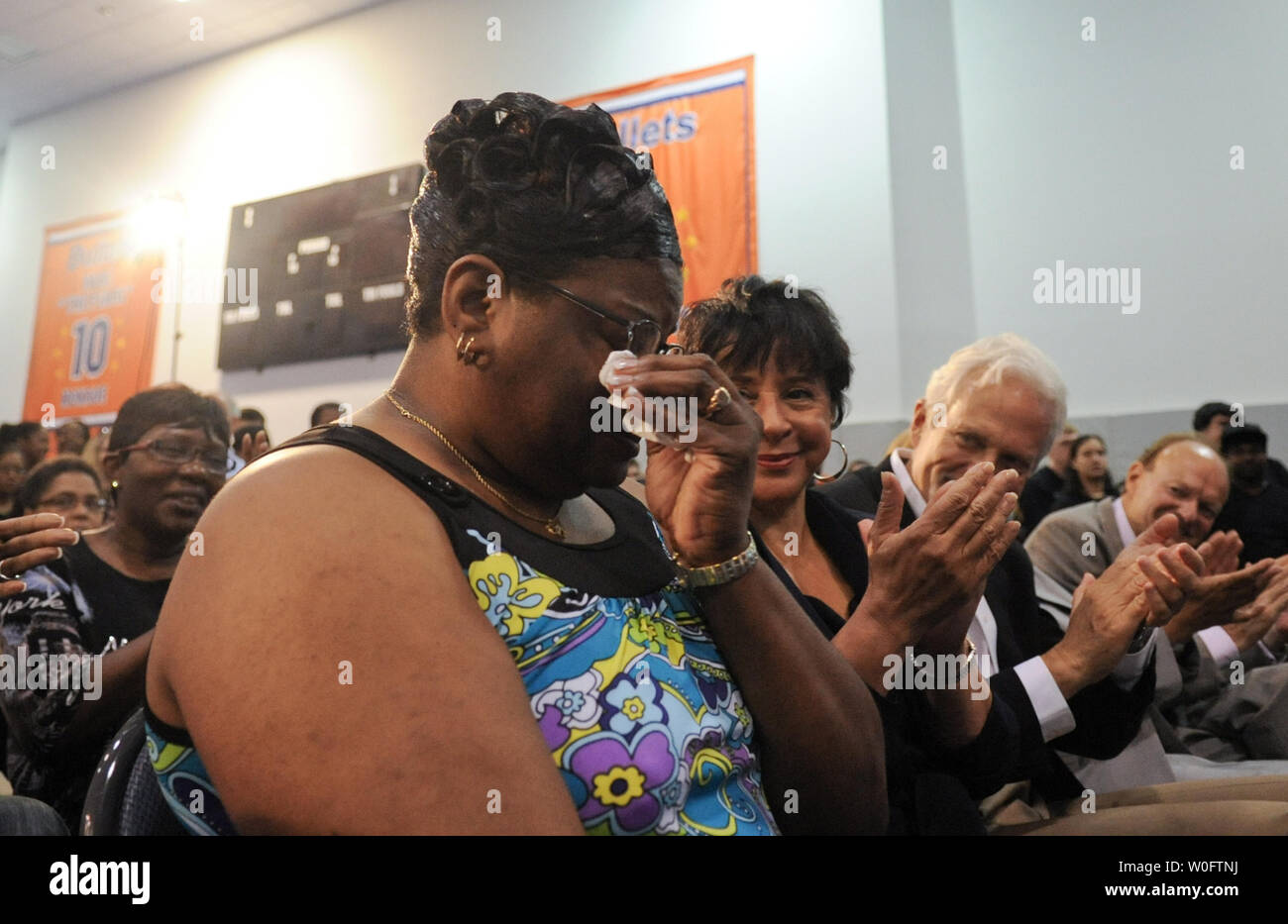 Frances Pulley (L), mother of John Wall, the NBA #1 draft pick by the Washington Wizards, wipes tears as guests applaud her at a press conference at the Verizon Center in Washington on June 25, 2010. UPI/Alexis C. Glenn Stock Photo