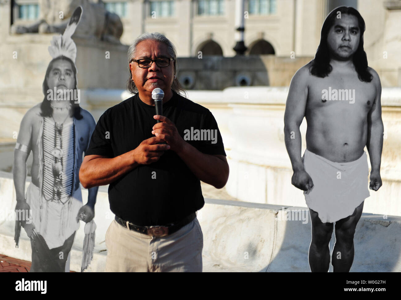 Performance artist James Luna speaks during his piece titled 'Take a Picture With a Real Indian,' in front of the Christopher Columbus Statue on Columbus Day in Washington on October 11, 2010. In the piece Luna invites members of the audience to pose with him as he confronts commonly held perceptions of Natives Americans.   UPI/Kevin Dietsch - Stock Image