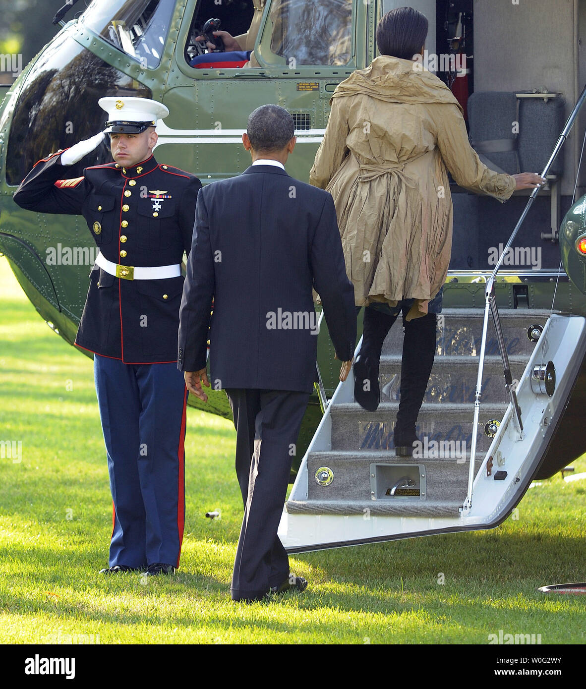 U.S. President Barack Obama and First Lady Michelle Obama embark Marine One on the South Lawn of the White House as they begin a ten day trip to Asia in Washington on November 5, 2010.   UPI/Roger L. Wollenberg Stock Photo