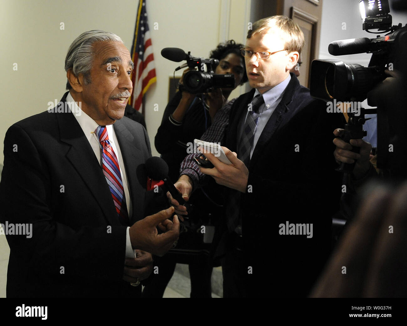 Rep. Charlie Rangel, D-NY, talks to reporters has he waits for an elevator near his office on Capitol Hill in Washington on November 15, 2010. Rangel walked out of a House Committee on Standards of Official Conduct hearing earlier today. He is facing financial misconduct charges.    UPI/Roger L. Wollenberg Stock Photo