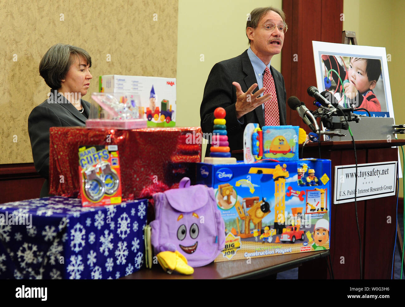 U.S. Consumer Product Safety Commissioner Robert Adler speaks during a news conference at which U.S. Public Interest Research Group (PIRG) announced its 25th annual Trouble in Toyland report, in Washington November 23, 2010. The report details test results for toxic chemicals in toys and calls to expand the small parts standard to prevent choking hazards. Abler was joined by U.S. PIRG Public Health Advocate Liz Hitchcock.  UPI/Kevin Dietsch Stock Photo