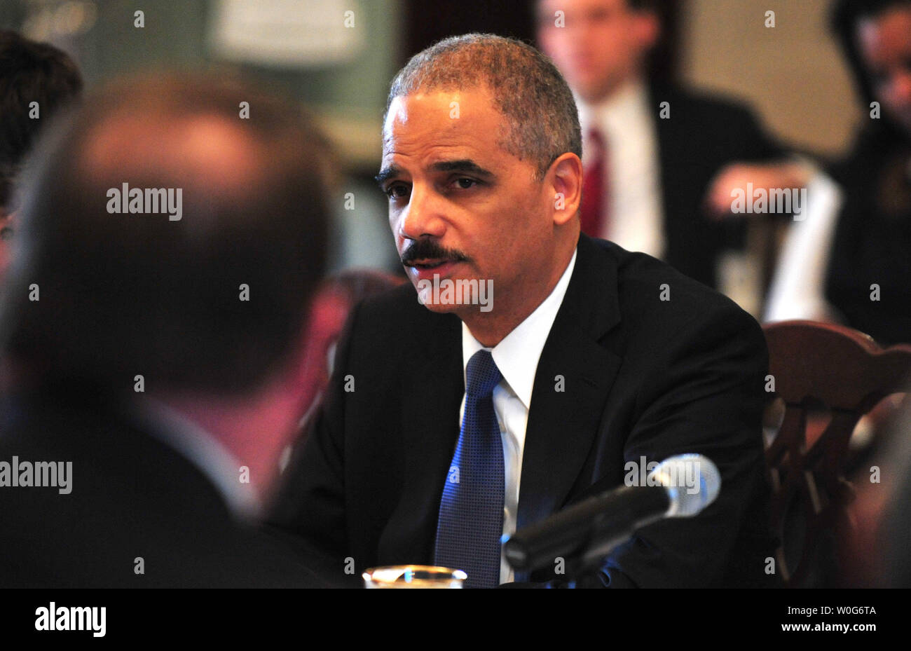 Attorney General Eric Holder speaks during the State Department's annual meeting of the President's Interagency Task Force to Monitor and Combat Trafficking in Persons, at the State Department in Washington on February 1, 2011. Stock Photo