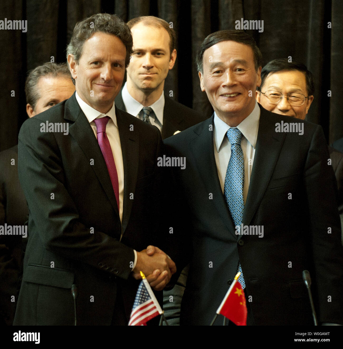 U.S. Treasury Secretary Tim Geithner shakes hands with Chinese Vice Premier Wang Qishan after signing the U.S.-China Comprehensive Framework for Promoting Strong, Sustainable, and Balanced Growth and Economic Cooperation agreement at the Treasury Department in Washington on May 10, 2011.  UPI/Kevin Dietsch - Stock Image