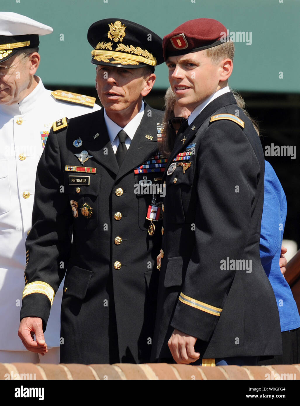 Gen. David Petraeus stands with his son Stephen, who served in Afghanistan, during an armed forces farewell tribute and retirement ceremony in his honor at Ft. Myer in Virginia on August 31, 2011. Petraeus will soon start his new job as Central Intelligence Agency (CIA) Director. With him are Chairman of the Joint Chiefs of Staff Adm. Michael Mullen (R) and Deputy Defense Secretary William Lynn.     UPI/Roger L. Wollenberg - Stock Image