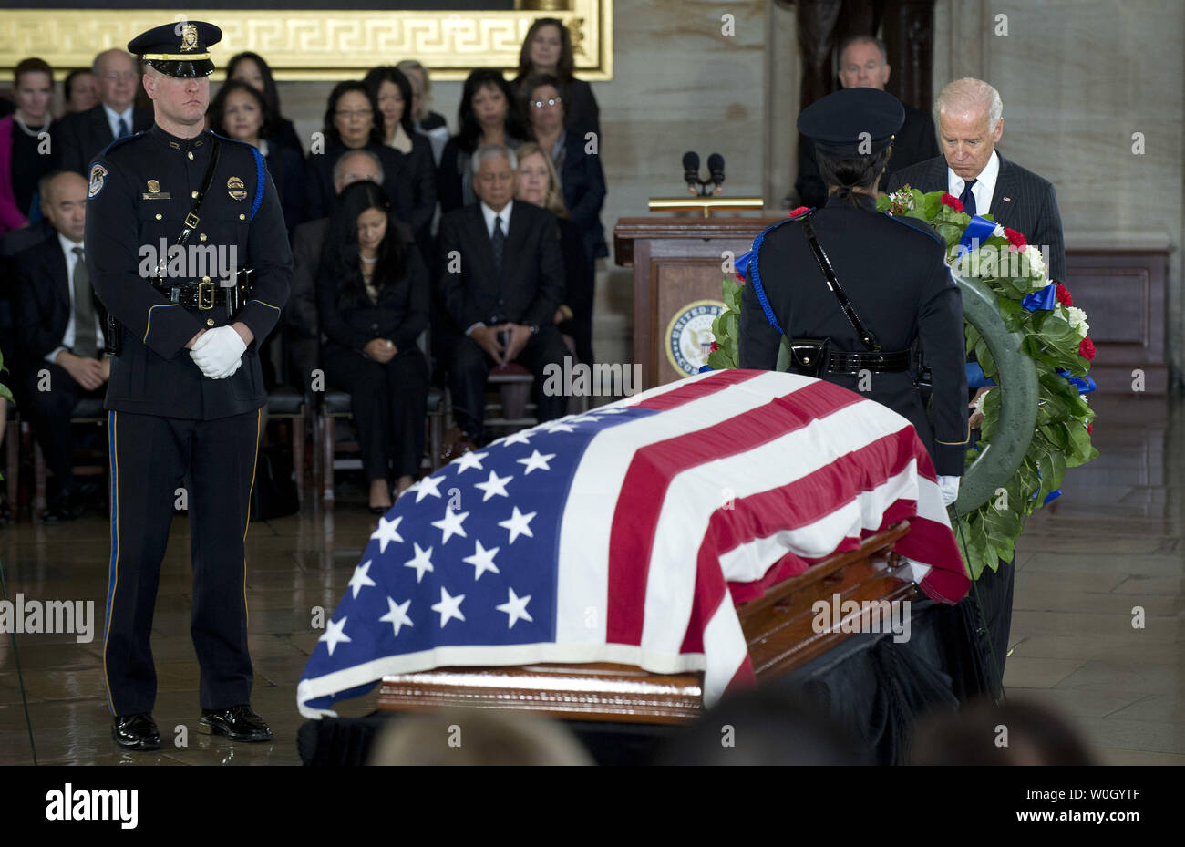 Vice President Joe Biden pays his respects to Sen. Daniel Inouye (D-HI) as he lies in state in the Capitol Rotunda in Washington, DC on December 20, 2012.  Sen. Inouye, the second-longest serving member of Senate, died Monday of respiratory complications.  UPI/Kevin Dietsch Stock Photo
