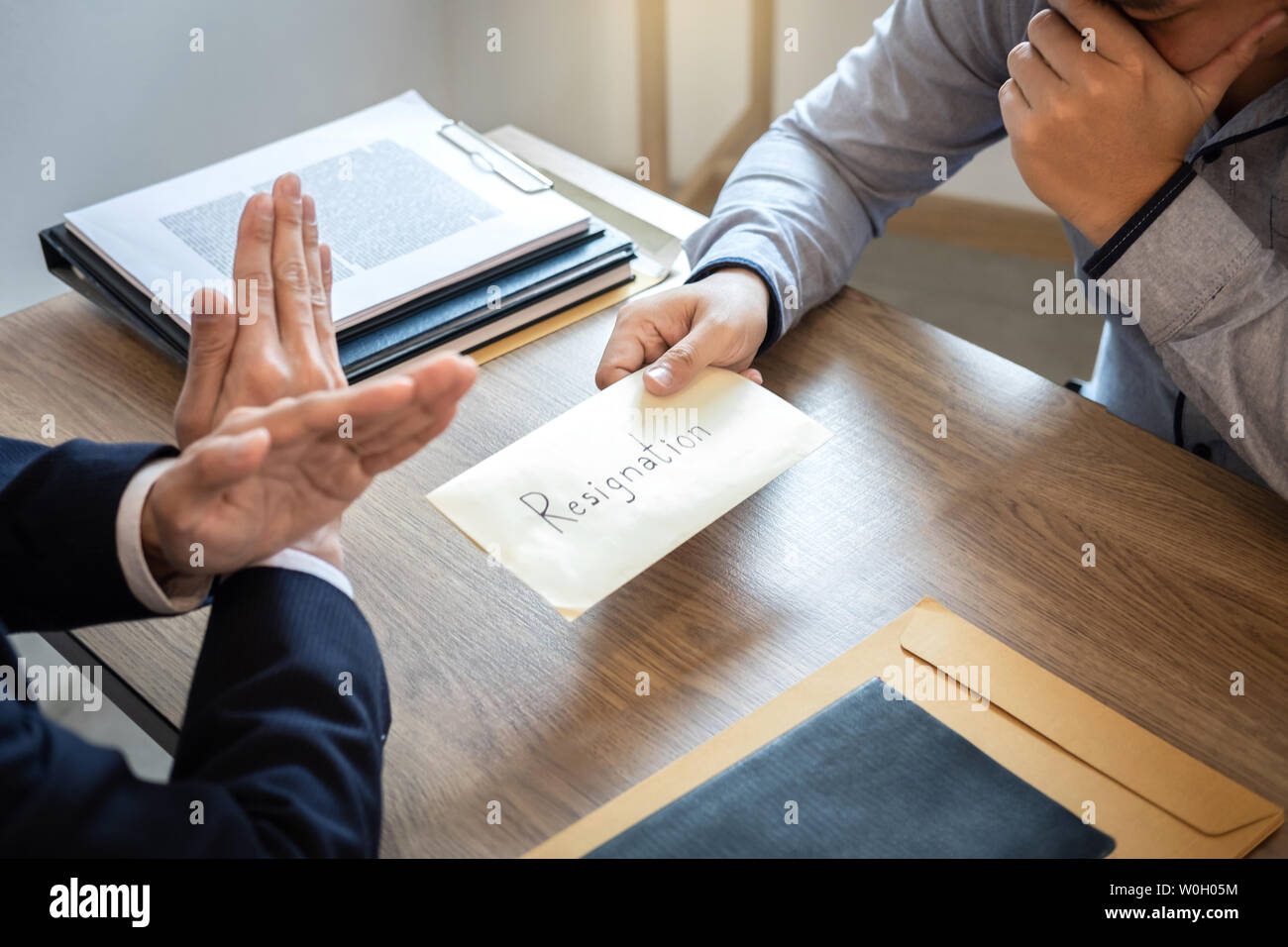 Businessman sending a resignation letter to employer boss in order to dismiss contract, changing and resigning from work concept. - Stock Image