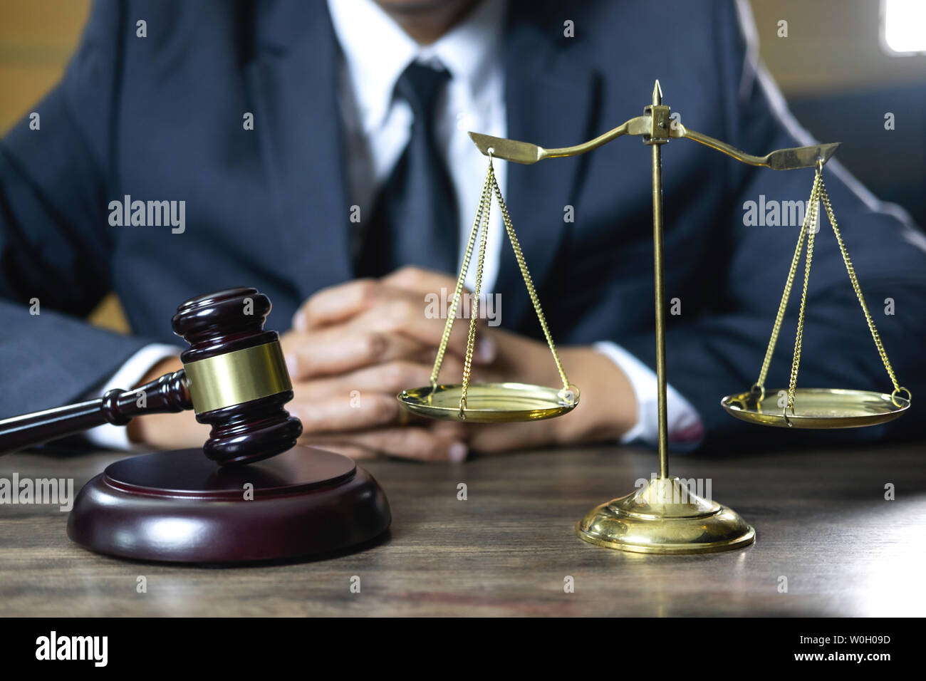 Legal law, advice and justice concept, male counseling lawyer or notary working on a documents and contract papers of the important case and wooden ga Stock Photo