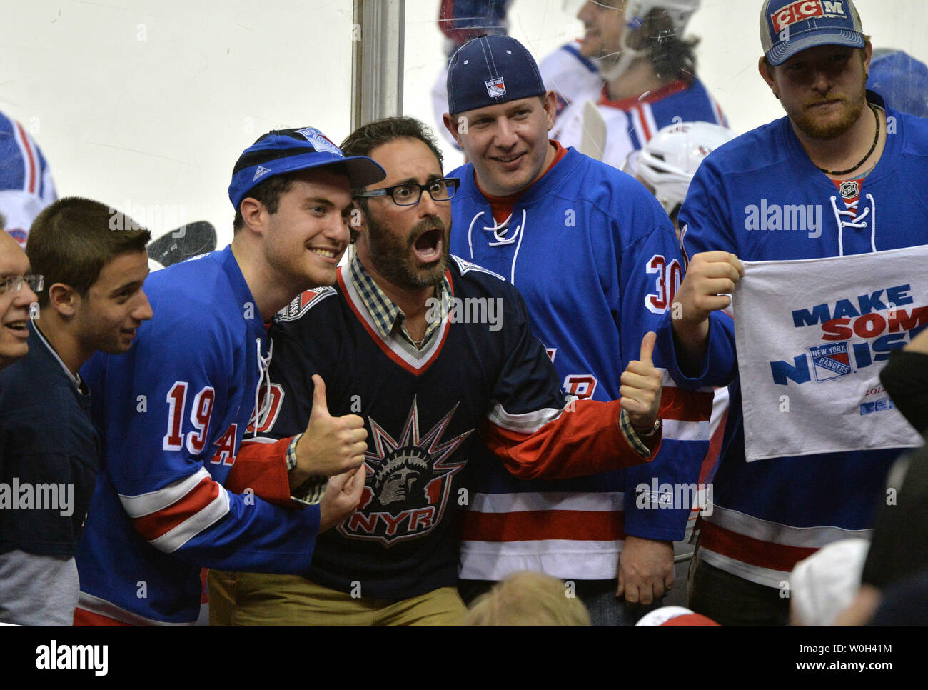 best loved 24ad2 876ad New York Rangers fans celebrate after the Rangers defeated ...