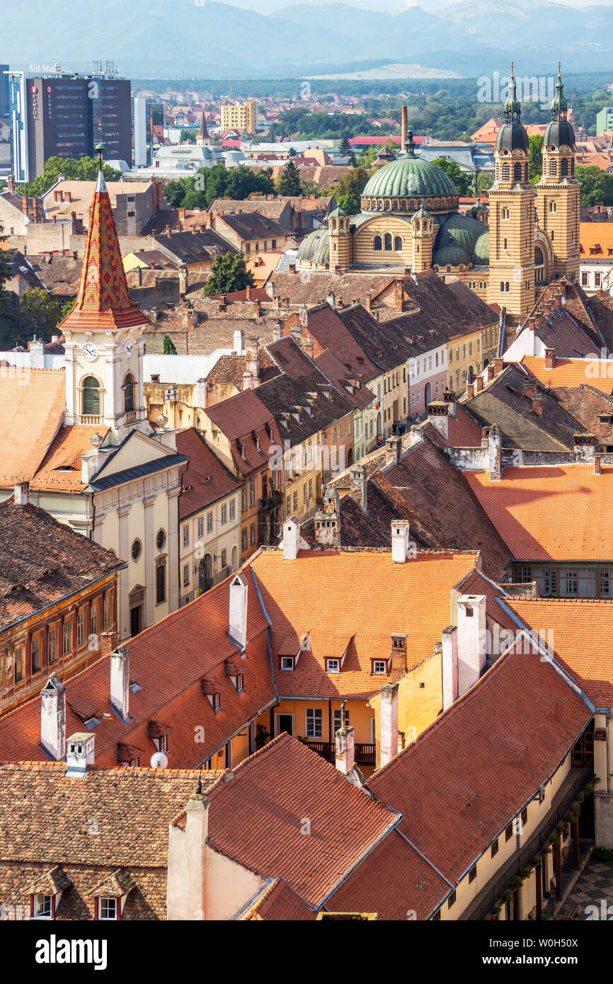 SIBIU, ROMANIA - AUGUST 28, 2017: Sibiu elevated cityscape with Holy Trinity Cathedral and the Reformed Church seen from the steeple of the Lutheran C Stock Photo