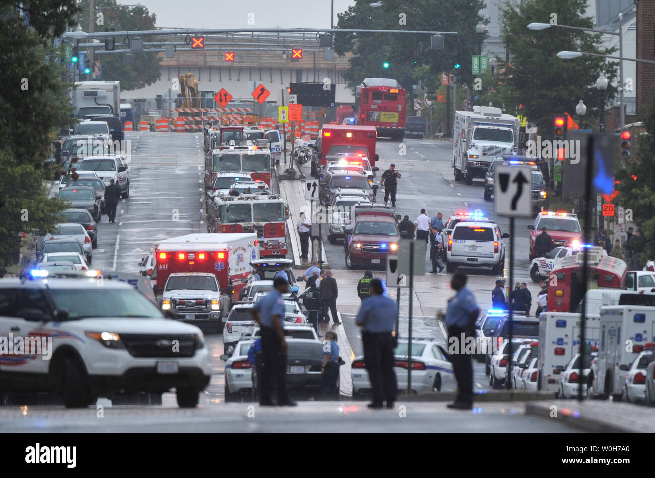 Emergency vehicles line the street near the Navy Yard, a huge complex of buildings located along the Anacostia River waterfront on September 16, 2013 in Washington, DC. A gunman killed at least four and wounded others before being killed by police in a running gun battle.     UPI/Kevin Dietsch Stock Photo