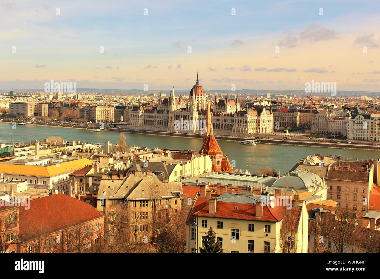 A view of the city of Budapest which is divided by the Danube river. In the centre is the Hungarian House of Parliament, which sits on the Pest side. Stock Photo