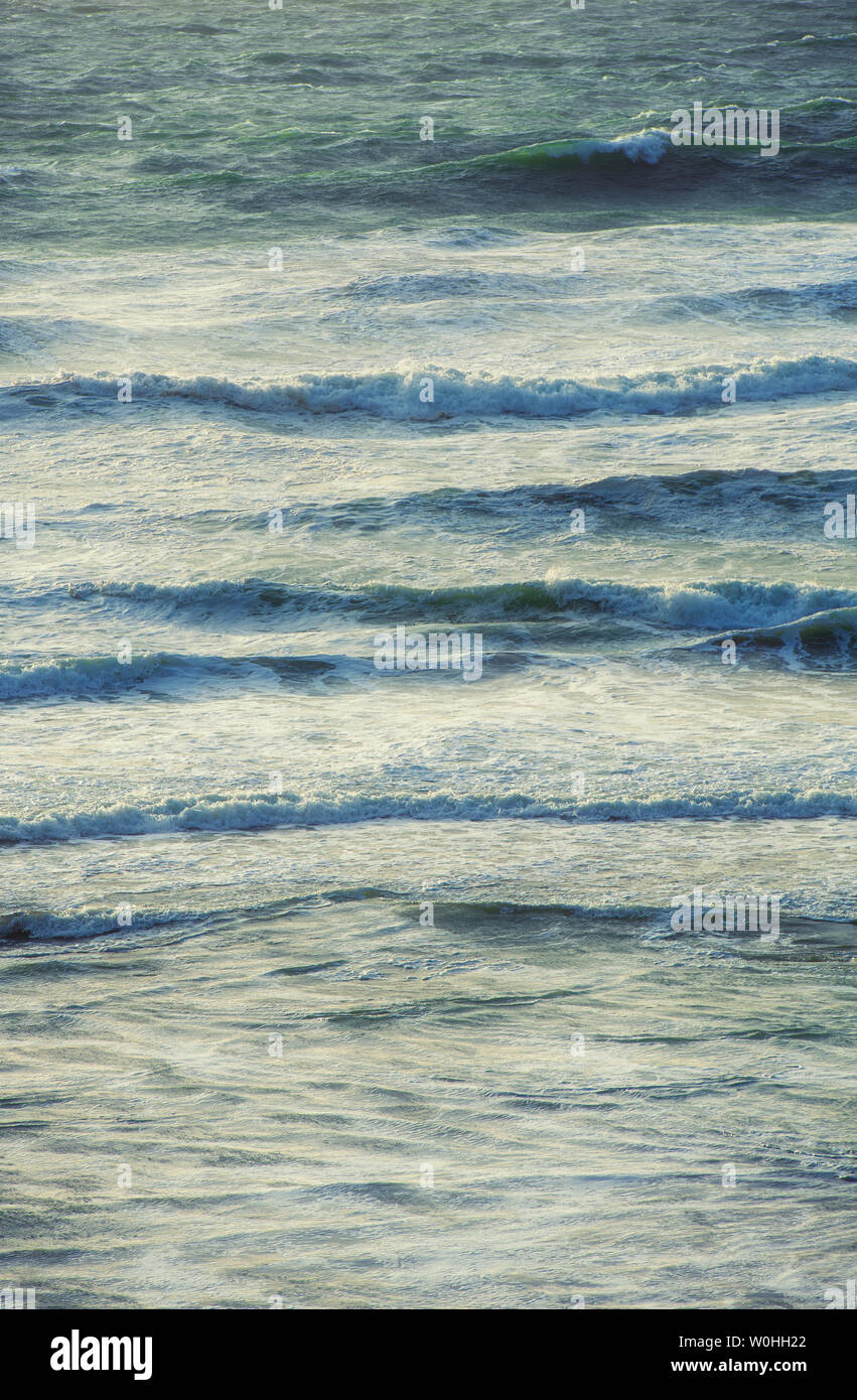 Waves and the incoming tide off the coast of Cornwall, England, UK Stock Photo