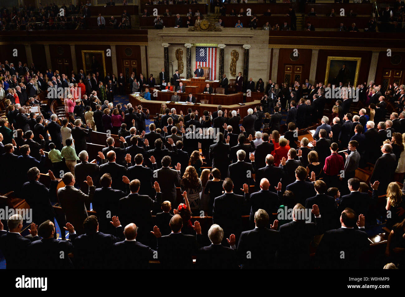 The 114th Congress is sworn-in by Speaker of the House John Boehner, R-OH, inside the House Chambers of the U.S. Capitol Building in Washington, D.C. on January 6, 2015. Photo by Kevin Dietsch/UPI - Stock Image