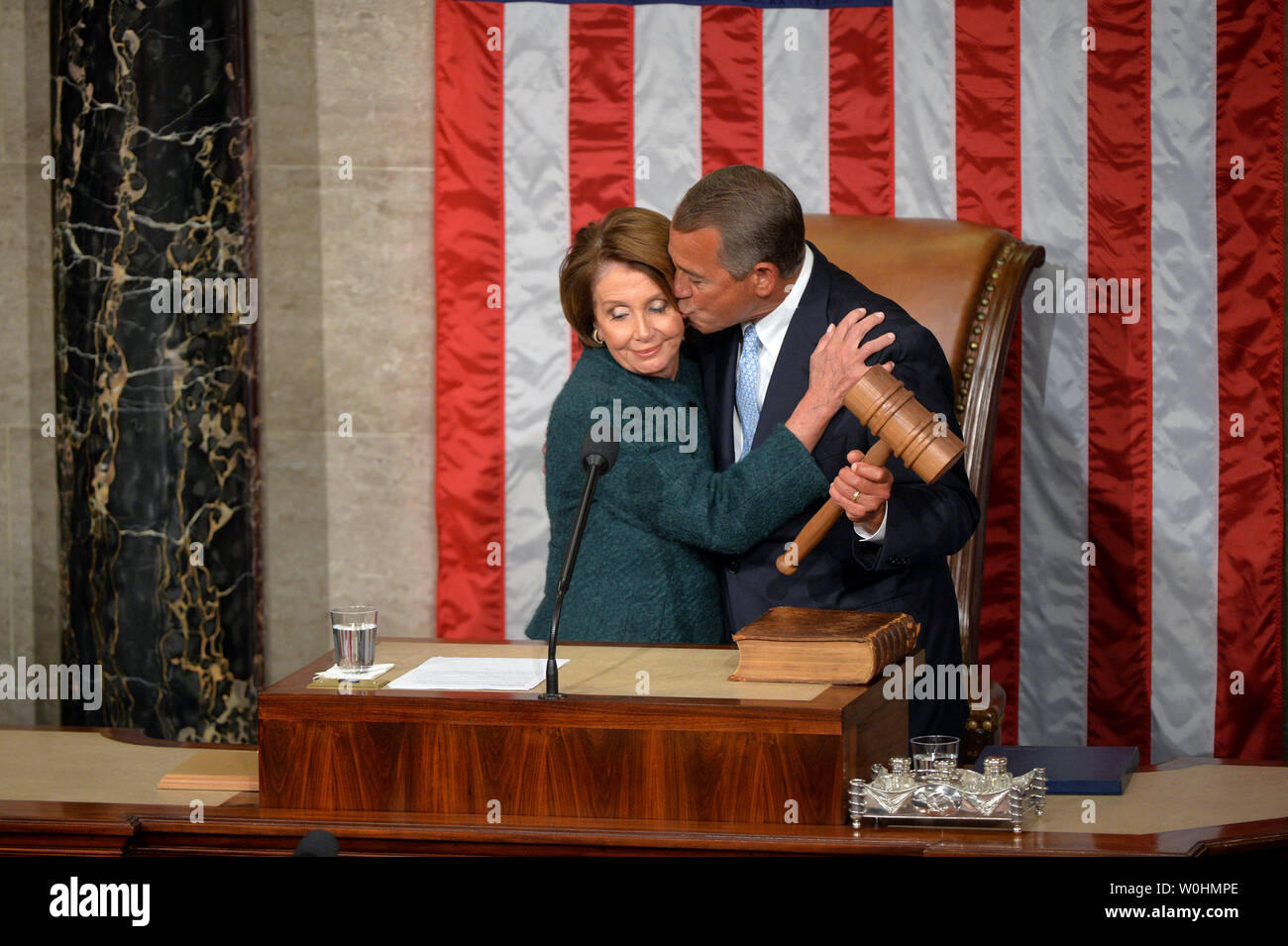 Speaker of the House John Boehner, R-OH, kisses House Minority Leader Nancy Pelosi, D-CA, after he was reelected as the Speaker during the first day of the 114th Congress, inside the House Chambers of the U.S. Capitol Building in Washington, D.C. on January 6, 2015. Photo by Kevin Dietsch/UPI - Stock Image