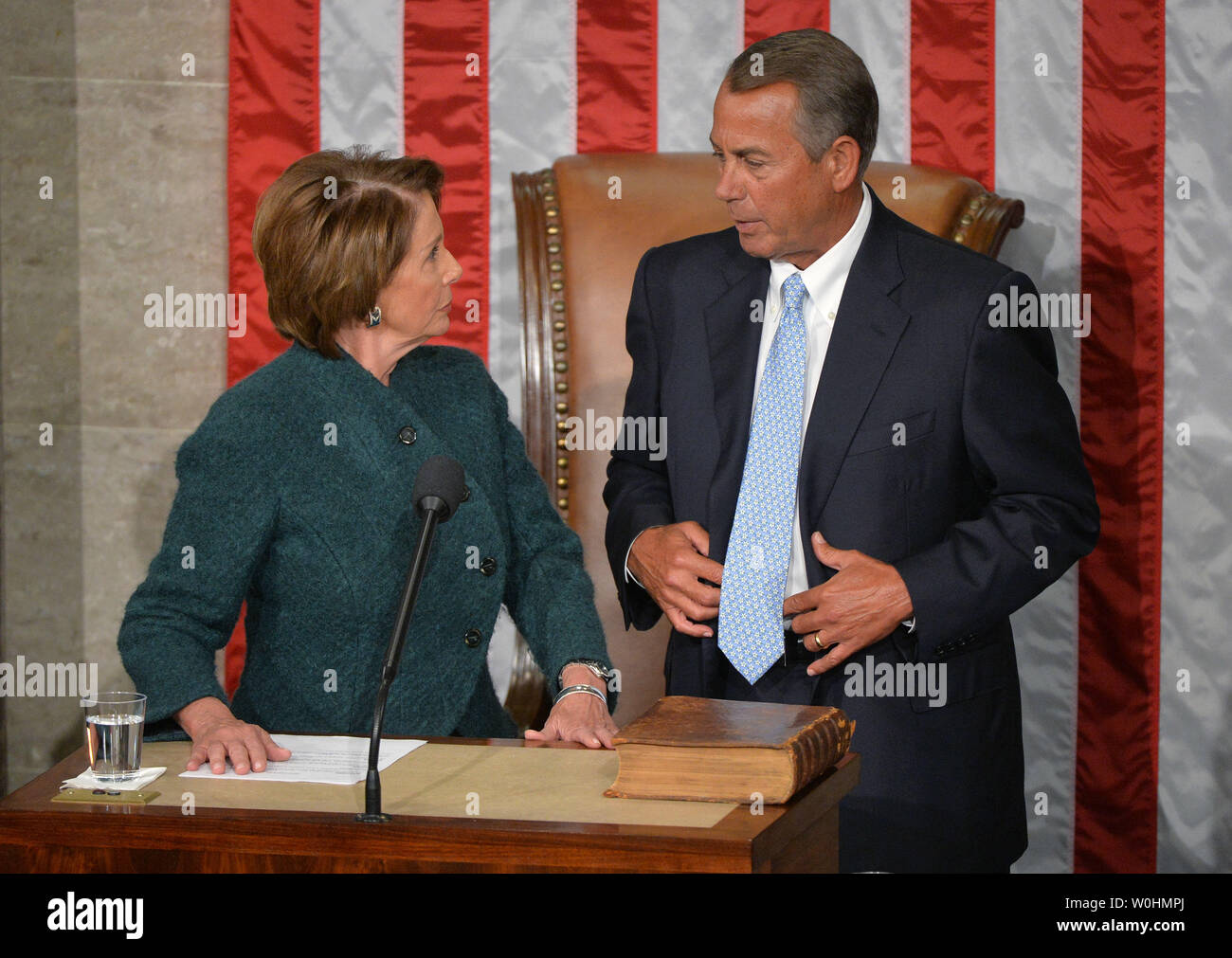 House Minority Leader Nancy Pelosi, D-CA, talks to Speaker of the House John Boehner, R-OH, after he was reelected as the Speaker during the first day of the 114th Congress, inside the House Chambers of the U.S. Capitol Building in Washington, D.C. on January 6, 2015. Photo by Kevin Dietsch/UPI - Stock Image