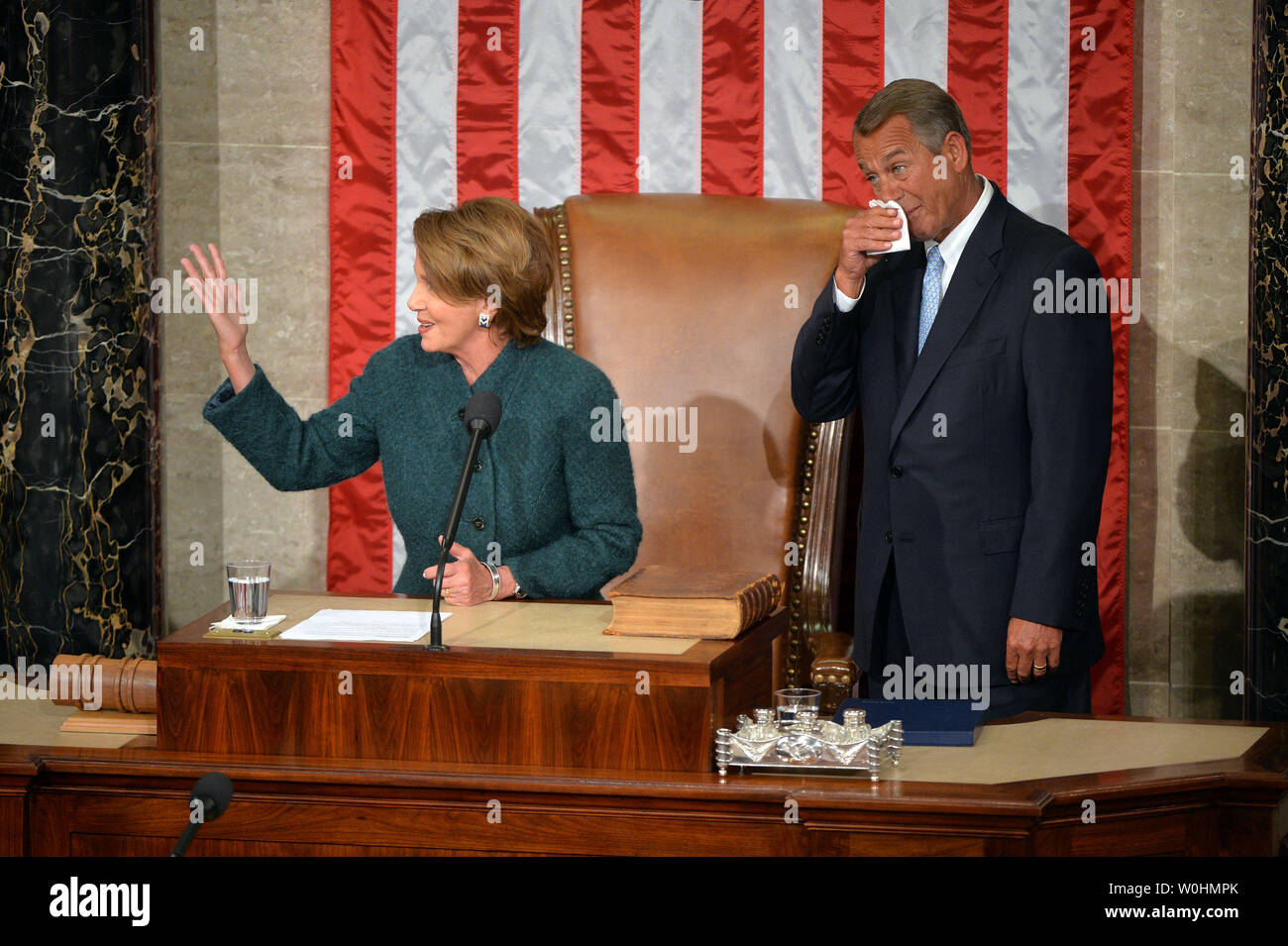 House Minority Leader Nancy Pelosi, D-CA, speaks as Speaker of the House John Boehner, R-OH, reacts, after he was reelected as the Speaker during the first day of the 114th Congress, inside the House Chambers of the U.S. Capitol Building in Washington, D.C. on January 6, 2015. Photo by Kevin Dietsch/UPI - Stock Image