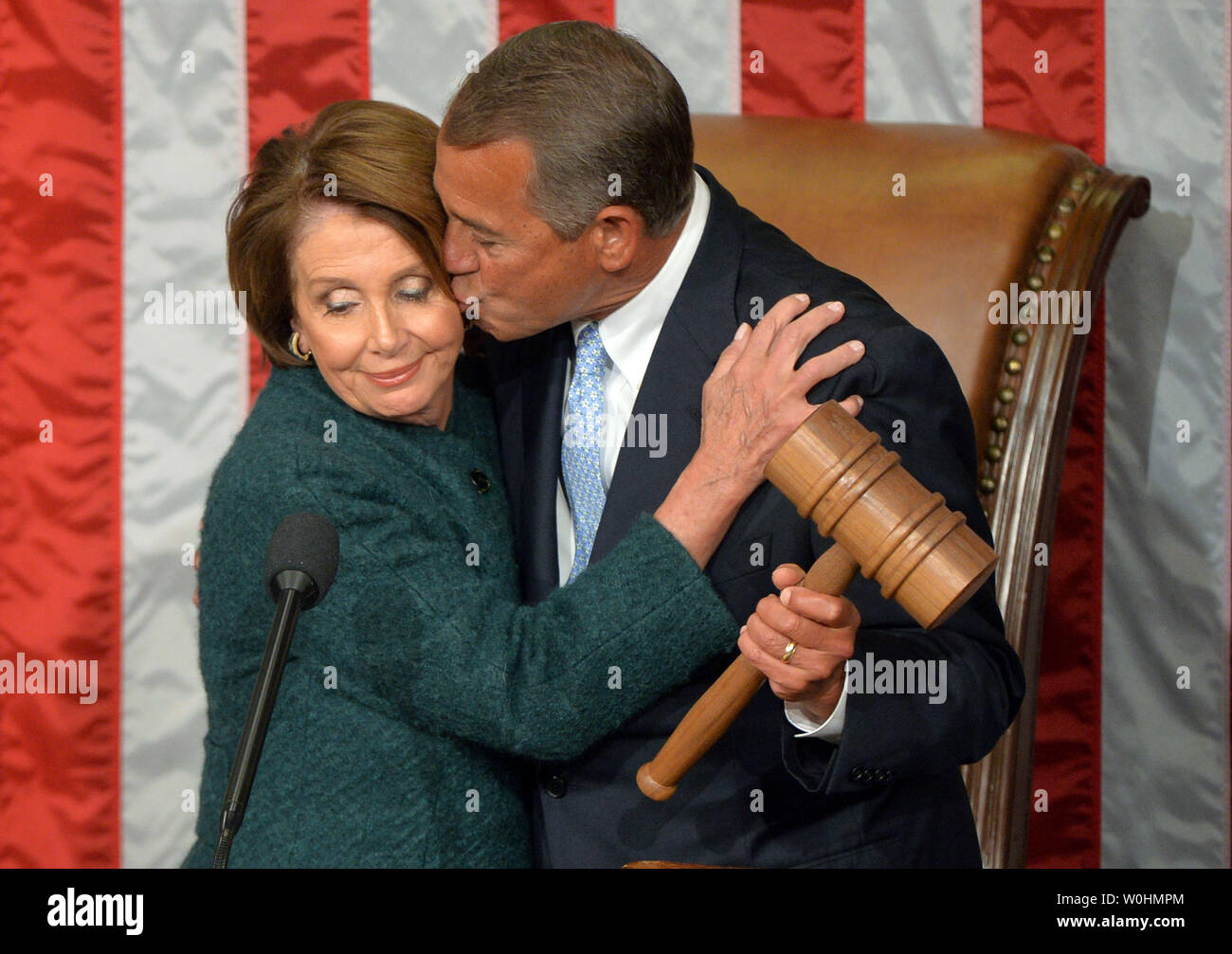 Speaker of the House John Boehner, R-OH, kisses House Minority Leader Nancy Pelosi, D-CA, after he was re-elected Speaker during the first day of the 114th Congress inside the House Chambers of the U.S. Capitol Building in Washington, D.C. on January 6, 2015. Photo by Kevin Dietsch/UPI - Stock Image
