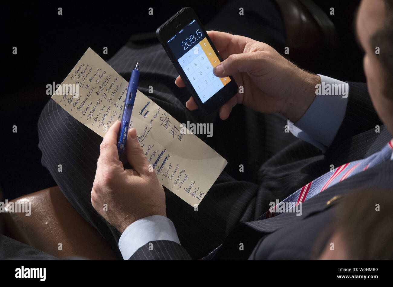 Rep. Marlin Stutzman, R-IN, add up votes during the election for Speaker of the House during the first day of the 114th Congress, inside the House Chambers of the U.S. Capitol Building in Washington, D.C. on January 6, 2015. Speaker John Boehner, R-OH, retained his position despite a Tea Party challenge. Photo by Kevin Dietsch/UPI - Stock Image