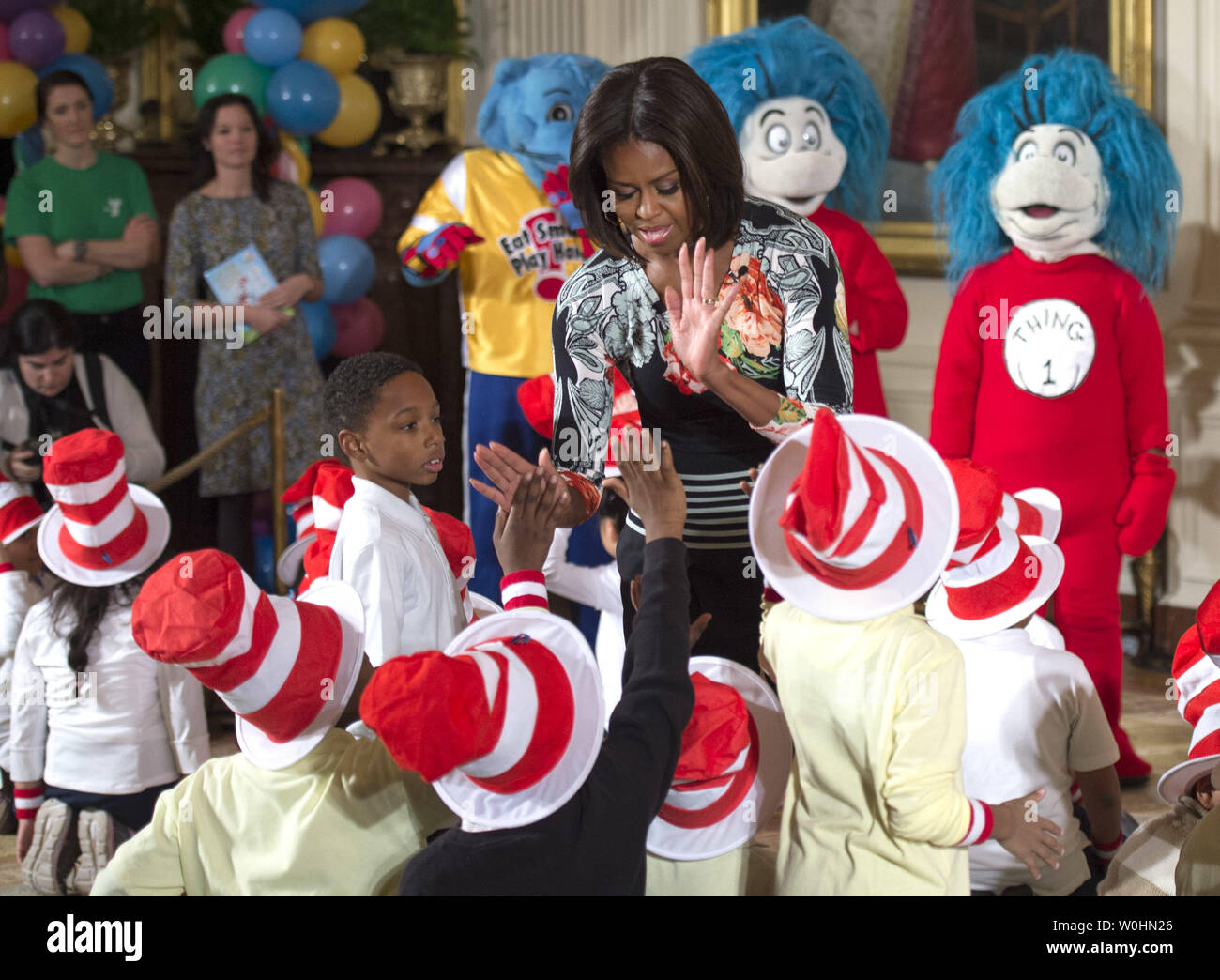 First Lady Michelle Obama greets school children after reading Dr. Seuss's book, 'Oh, The Things You Can Do That Are Good for You: All About Staying Healthy,'  in the East Room at the White House in Washington, D.C. on January 21, 2015. The event was part of the First Lady's Let's Move! initiative to inform children about making health life decisions and staying active. Photo by Kevin Dietsch/UPI - Stock Image