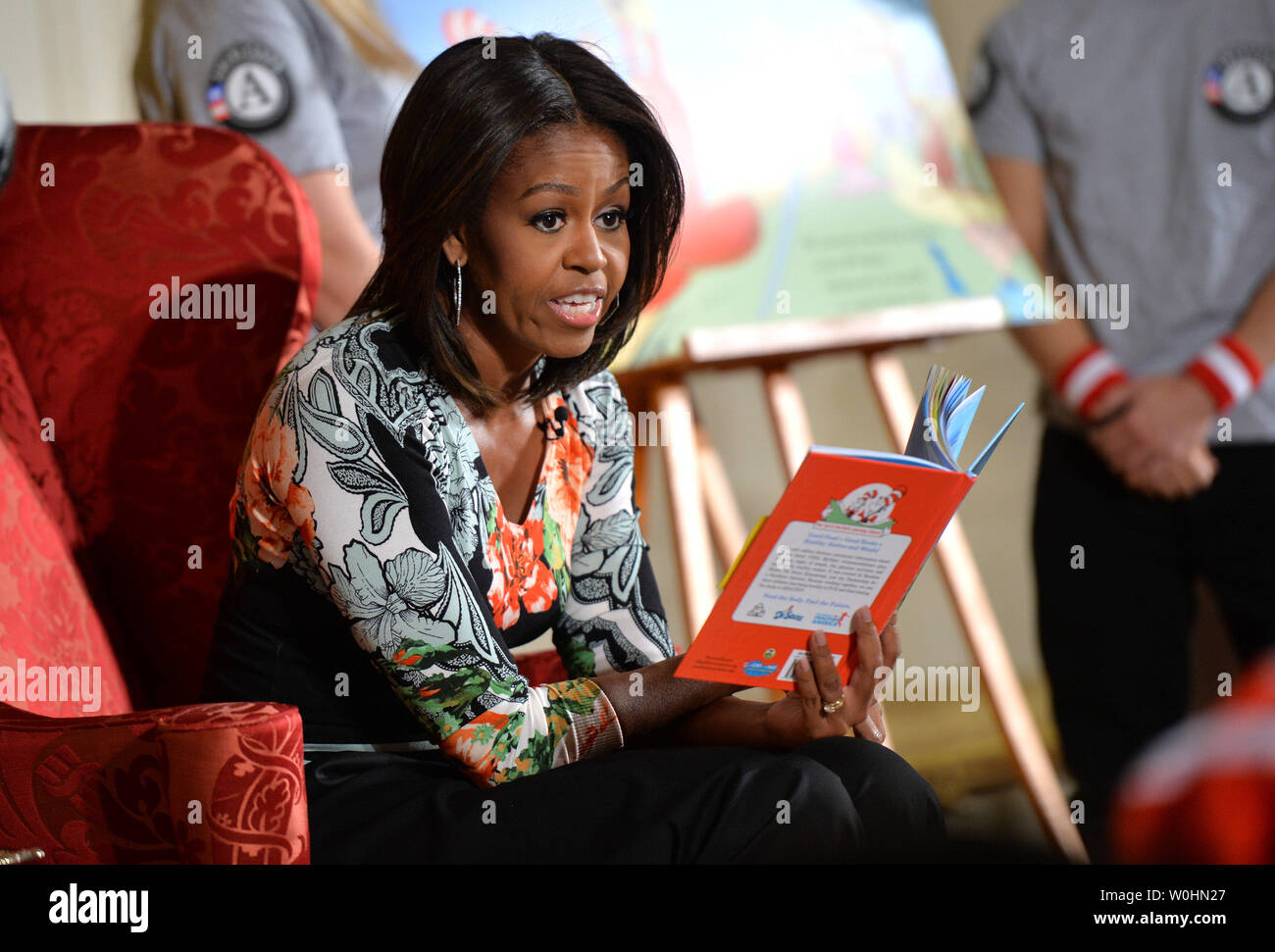First Lady Michelle Obama reads Dr. Seuss's book, 'Oh, The Things You Can Do That Are Good for You: All About Staying Healthy' to a group of school children in the East Room at the White House in Washington, D.C. on January 21, 2015. The event was part of the First Lady's Let's Move! initiative to inform children about making health life decisions and staying active. Photo by Kevin Dietsch/UPI - Stock Image