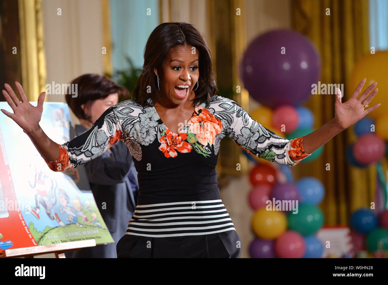 First Lady Michelle Obama arrives to read Dr. Seuss's book, 'Oh, The Things You Can Do That Are Good for You: All About Staying Healthy' to a group of school children in the East Room at the White House in Washington, D.C. on January 21, 2015. The event was part of the First Lady's Let's Move! initiative to inform children about making health life decisions and staying active. Photo by Kevin Dietsch/UPI - Stock Image