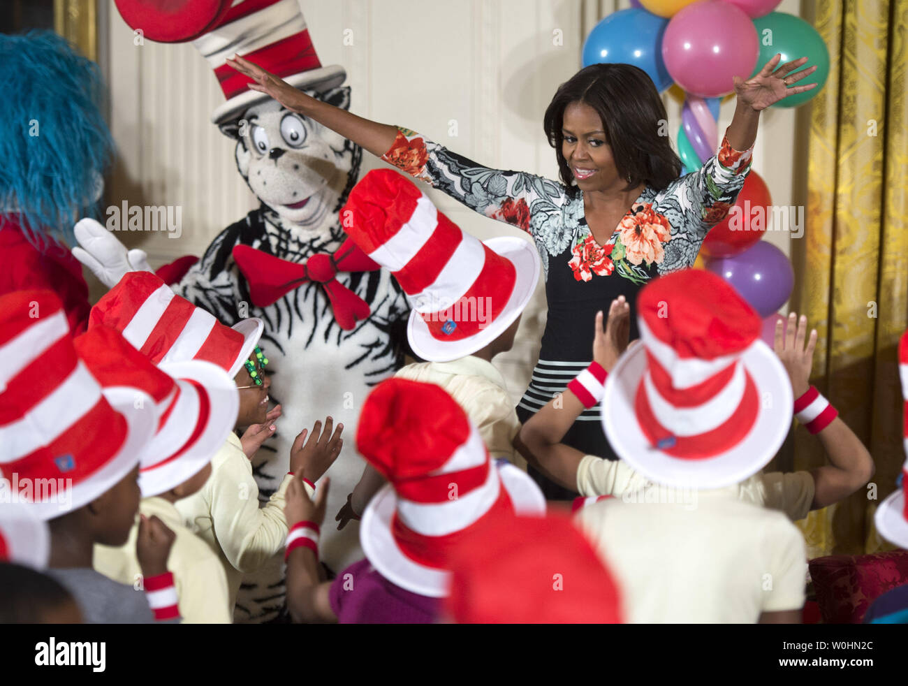 First Lady Michelle Obama dances with school children after reading Dr. Seuss's book, 'Oh, The Things You Can Do That Are Good for You: All About Staying Healthy,'  in the East Room at the White House in Washington, D.C. on January 21, 2015. The event was part of the First Lady's Let's Move! initiative to inform children about making health life decisions and staying active. Photo by Kevin Dietsch/UPI - Stock Image