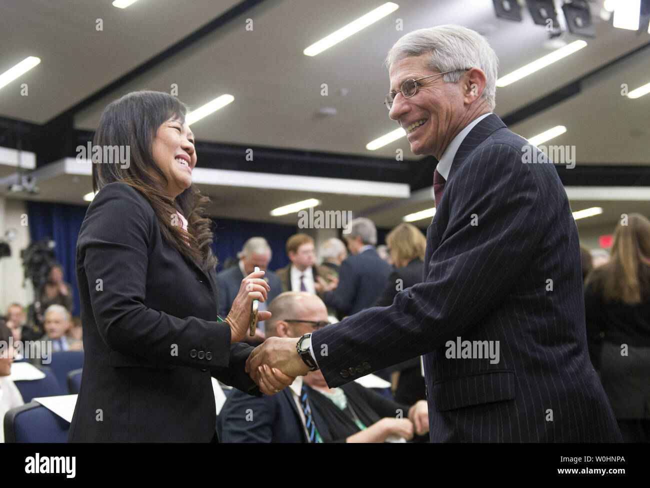 NIH Director Anthony S  Fauci greets Diana Pham the mother