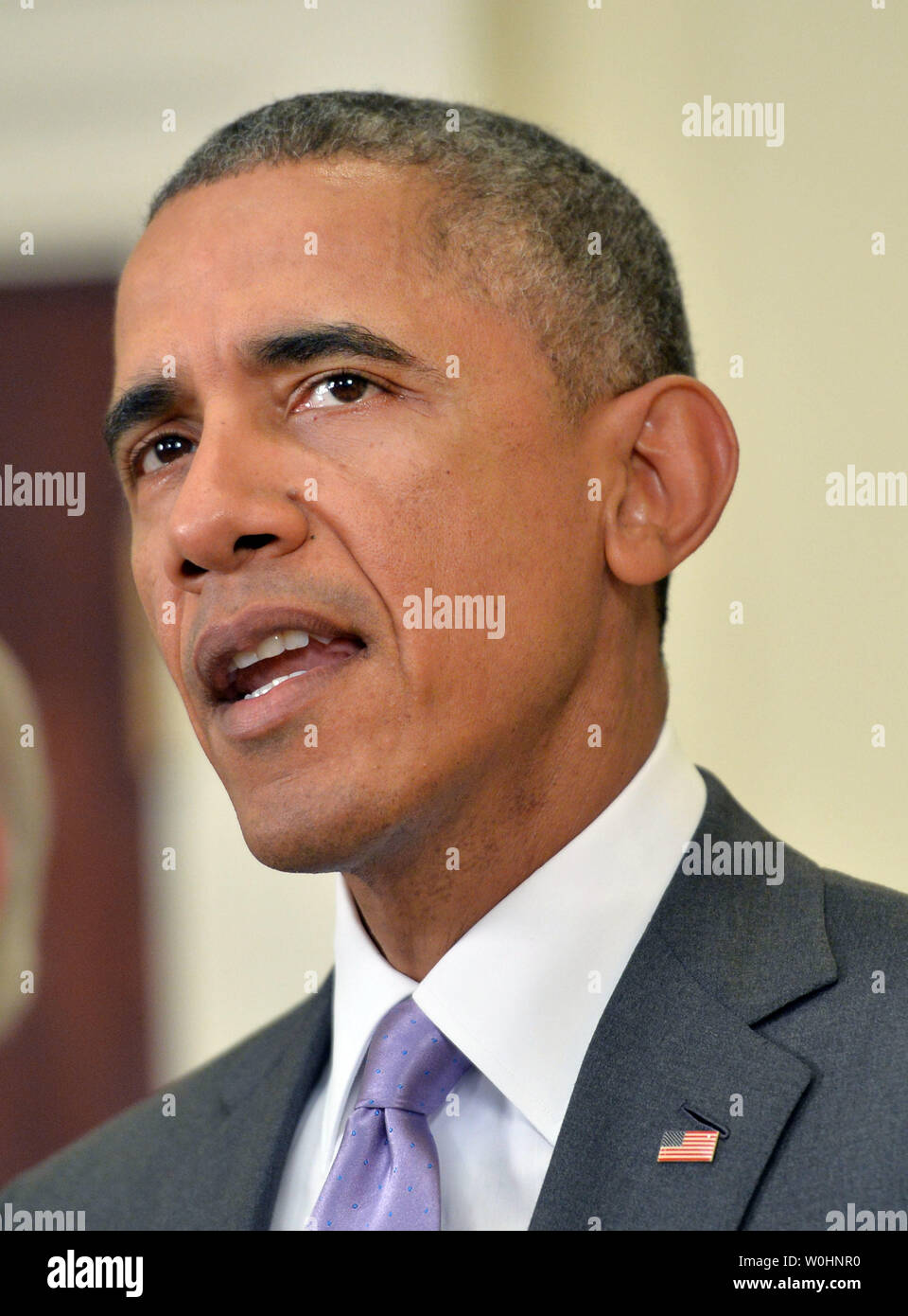 President Barack Obama speaks on requesting Congress to authorize military action against the Islamic State, at the White House in Washington, D.C. on February 11, 2015. Photo by Kevin Dietsch/UPI - Stock Image