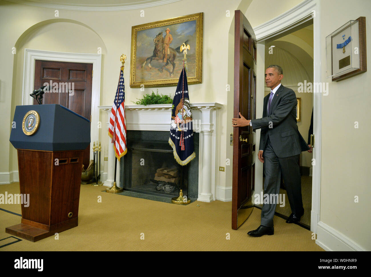 President Barack Obama arrives to speak on requesting Congress to authorize military action against the Islamic State, at the White House in Washington, D.C. on February 11, 2015.  Photo by Kevin Dietsch/UPI - Stock Image