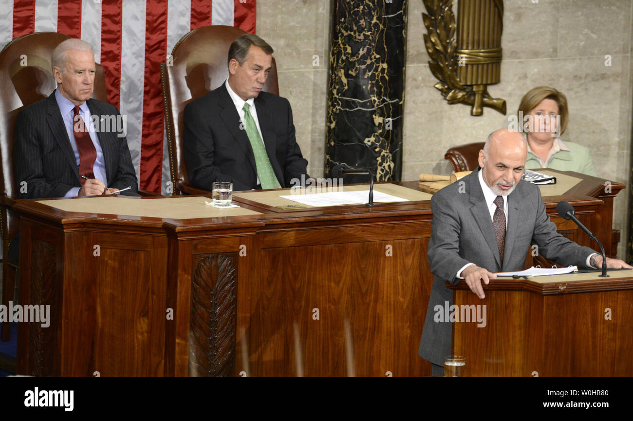 Afghanistan President Ashraf Ghani makes remarks to a joint meeting of Congress, as Vice President Joe Biden (L) and House Speaker John Boehner (R-OH) listen, March 25, 2015, in Washington, DC. Ghani is on a multi-day visit to Washington and has received assurances from President Obama to halt the withdrawal of U.S. troops to provide more time for training Afghan forces.   Photo by Mike Theiler/UPI - Stock Image