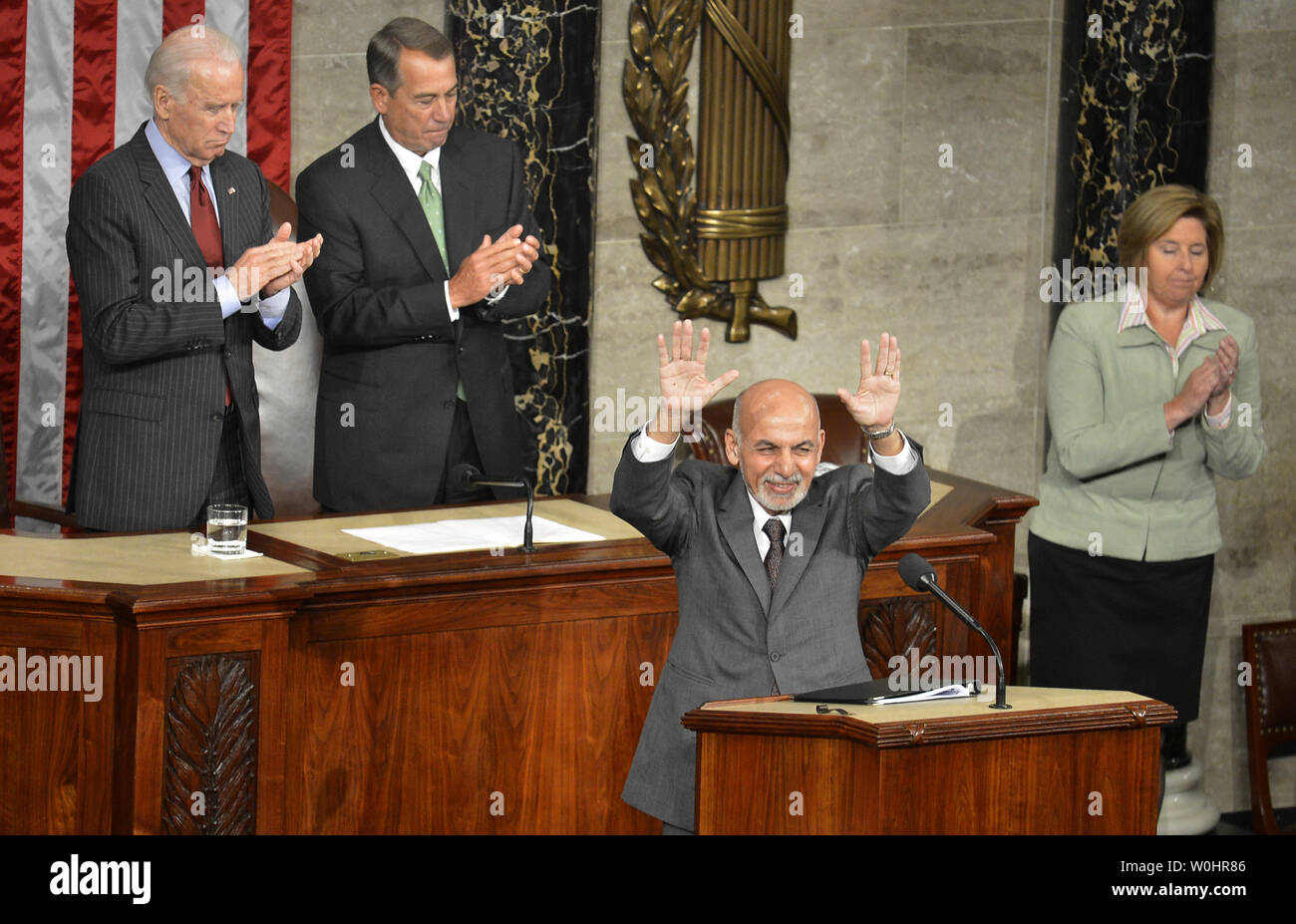 Afghanistan President Ashraf Ghani acknowledges applause as he makes remarks to a joint meeting of Congress, as Vice President Joe Biden (L) and House Speaker John Boehner (R-OH) listen, March 25, 2015, in Washington, DC. Ghani is on a multi-day visit to Washington and has received assurances from President Obama to halt the withdrawal of U.S. troops to provide more time for training Afghan forces.              Photo by Mike Theiler/UPI - Stock Image