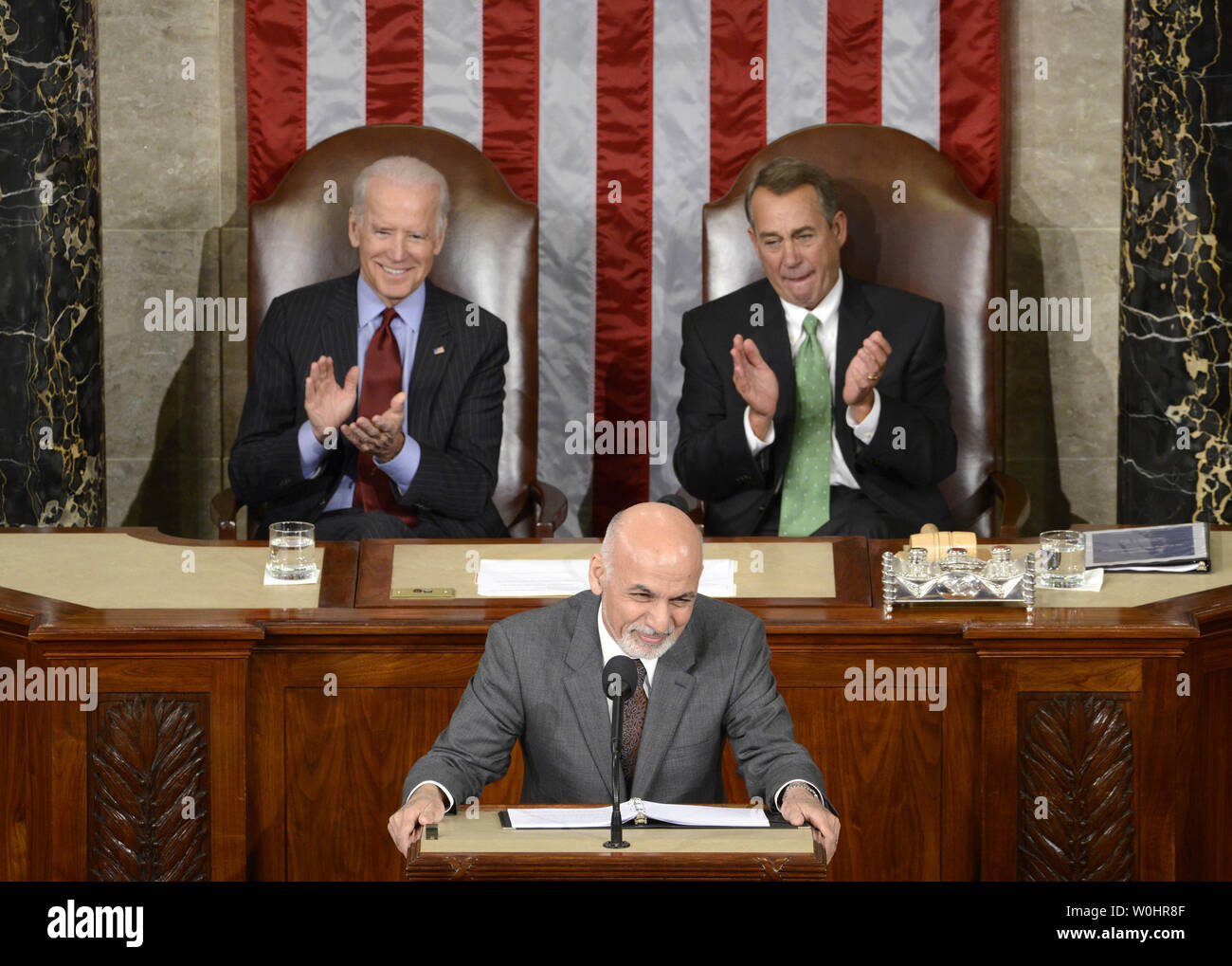 Afghanistan President Ashraf Ghani pauses during applause as he makes remarks to a joint meeting of Congress, as Vice President Joe Biden (L) and House Speaker John Boehner (R-OH) listen, March 25, 2015, in Washington, DC. Ghani is on a multi-day visit to Washington and has received assurances from President Obama to halt the withdrawal of U.S. troops to provide more time for training Afghan forces.             Photo by Mike Theiler/UPI - Stock Image