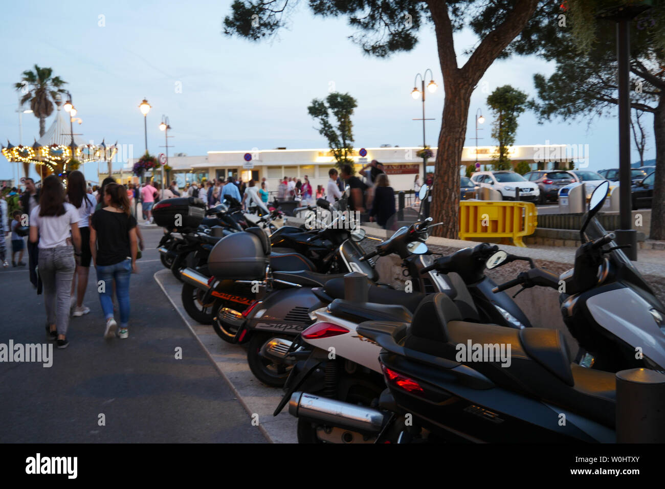 People wander in the street at twilight, Cassis, Bouches-du-Rhone, France Stock Photo