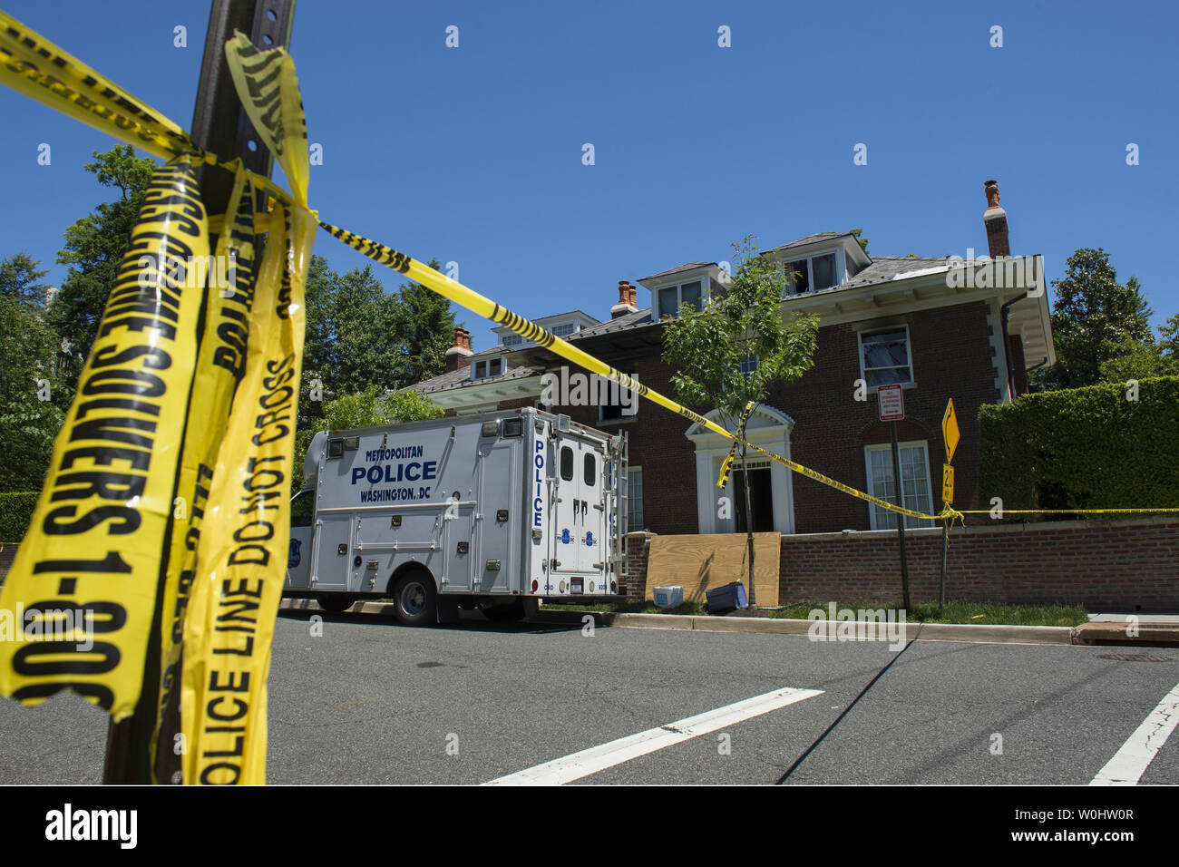 Police continue to inspect the $5 million house in the fashionable Northwest district of Washington, DC on May 23, 2015, where four people were brutally murdered after an apparent ransom was paid on May 14, 2015.  Police say captured suspect Daron Dylon Wint appeared to have accomplices in the murder of Savvas Savopoulos, his wife Amy, son Philip and housekeeper Veralicia Figueroa.  The lead on Wint apparently came from his DNA on a pizza crust.  Photo by Pat Benic/UPI - Stock Image