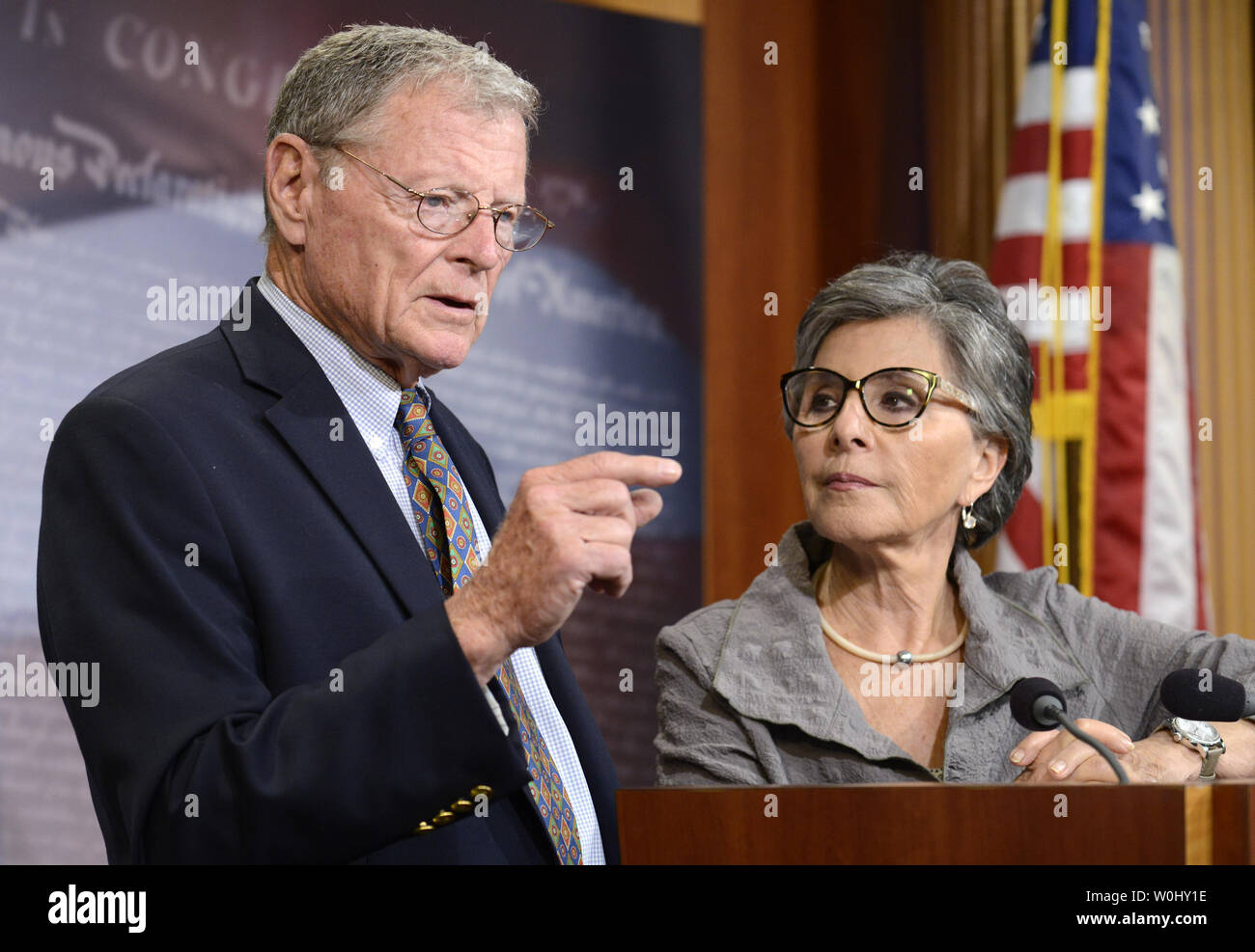 Sen. James Imhofe (R-OK), (L), makes remarks as Sen. Barbara Boxer (D-CA)   listens on bipartisan legislation to continue funding the Federal Highway Trust Fund, at the U.S. Capitol, July 30, 2015, in Washington, DC. Congress appears ready to pass a temporary spending 'patch' since the House has already recessed for the summer.        Photo by Mike Theiler/UPI - Stock Image