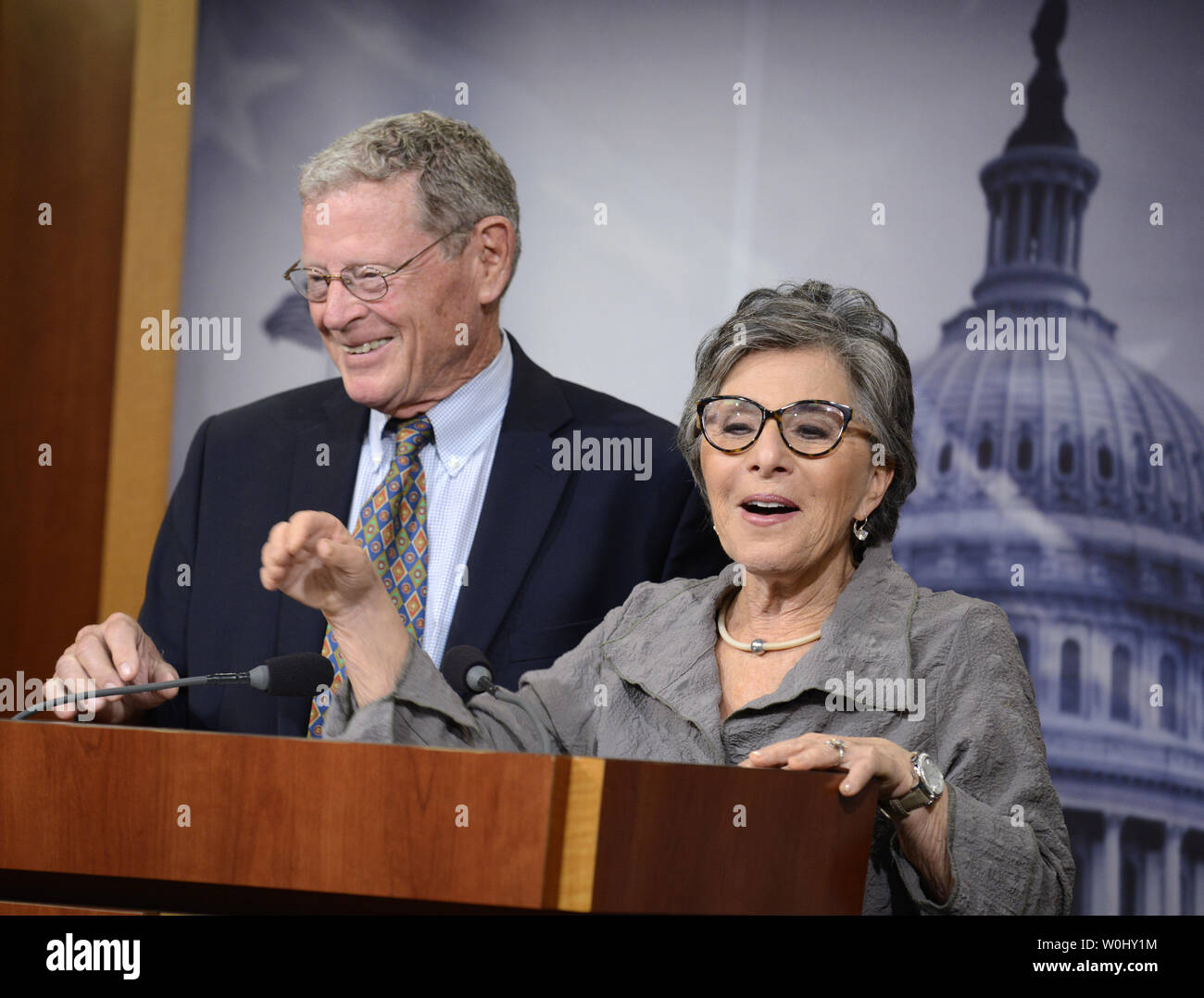 Sen. Barbara Boxer (D-CA), (R), makes remarks as Sen. James Imhofe (R-OK) listens on bipartisan legislation to continue funding the Federal Highway Trust Fund, at the U.S. Capitol, July 30, 2015, in Washington, DC. Congress appears ready to pass a temporary spending 'patch' since the House has already recessed for the summer.        Photo by Mike Theiler/UPI - Stock Image